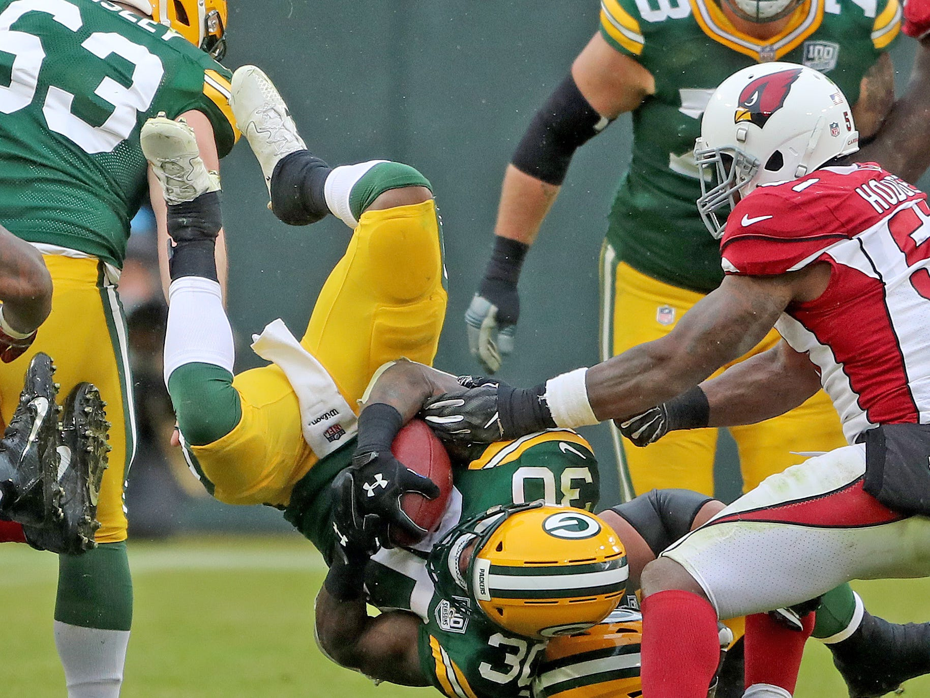 Green Bay Packers running back Jamaal Williams (30) gets flipped on a run against the Arizona Cardinals Sunday, December 2, 2018 at Lambeau Field in Green Bay, Wis. Jim Matthews/USA TODAY NETWORK-Wis