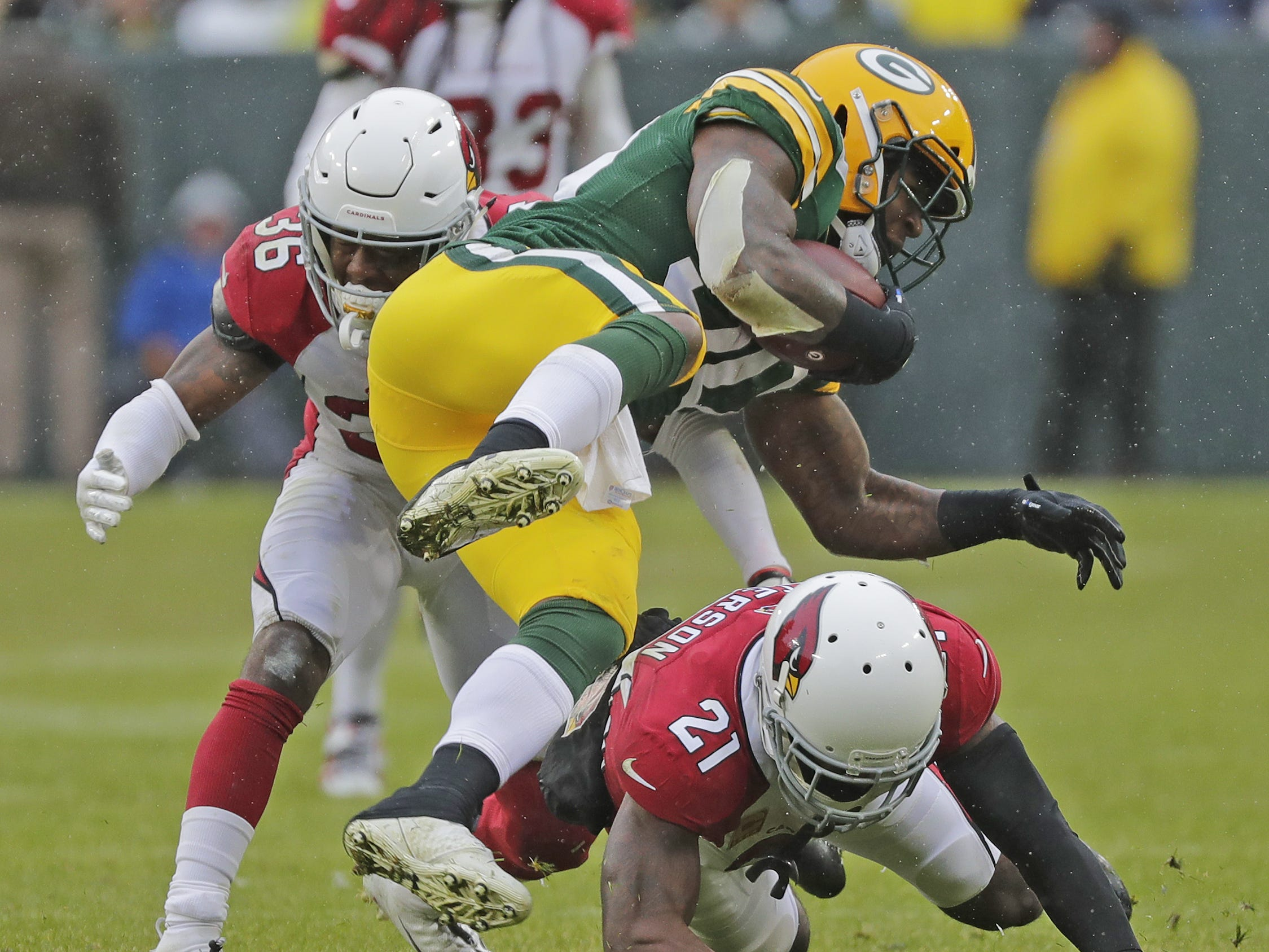 Arizona Cardinals cornerback Patrick Peterson (21) tackles Green Bay Packers running back Jamaal Williams (30) in the third quarter at Lambeau Field on Sunday, December 2, 2018 in Green Bay, Wis.