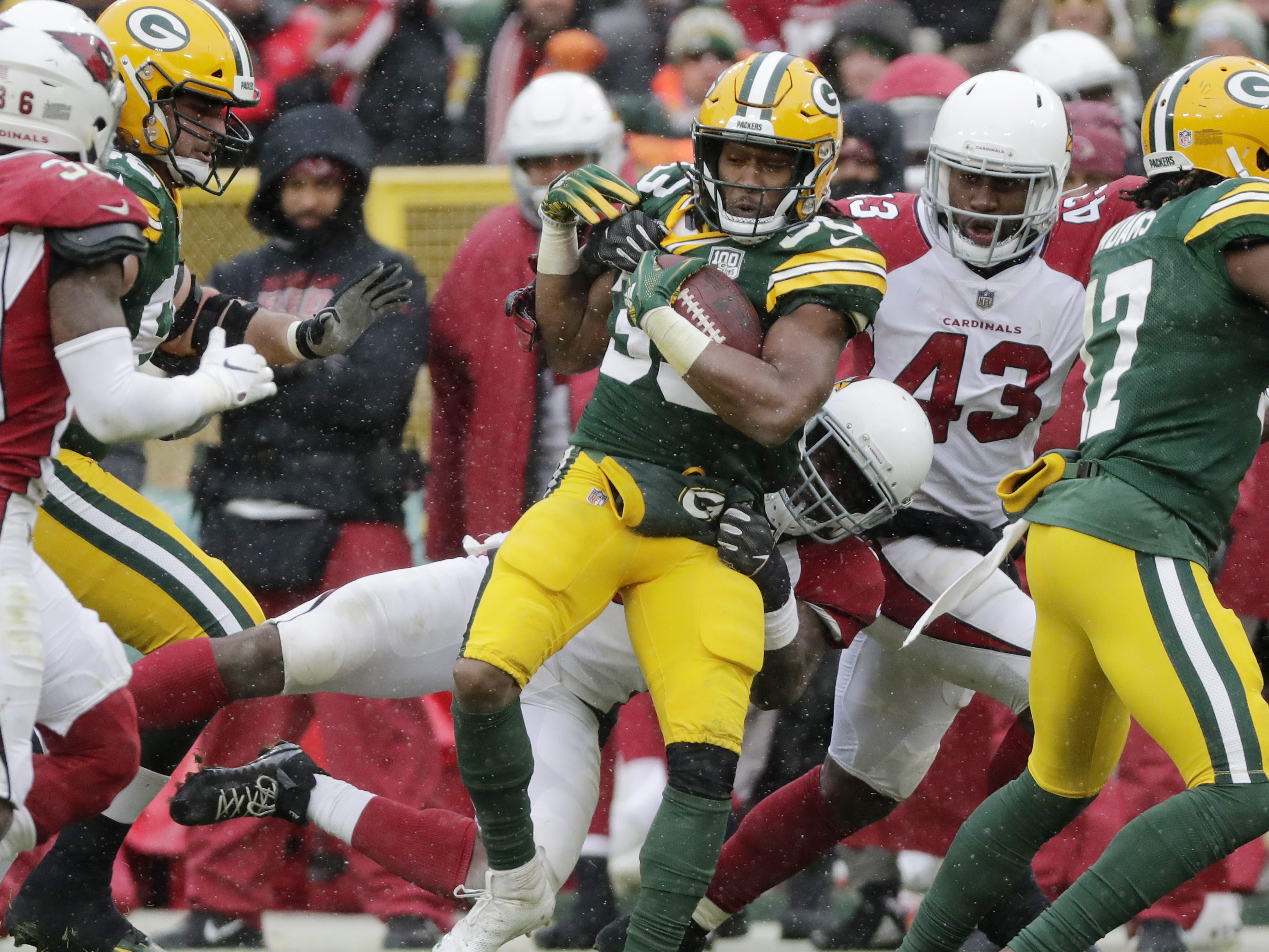 Green Bay Packers running back Aaron Jones (33) runs after a catch against the Arizona Cardinals in the third quarter at Lambeau Field on Sunday, December 2, 2018 in Green Bay, Wis.