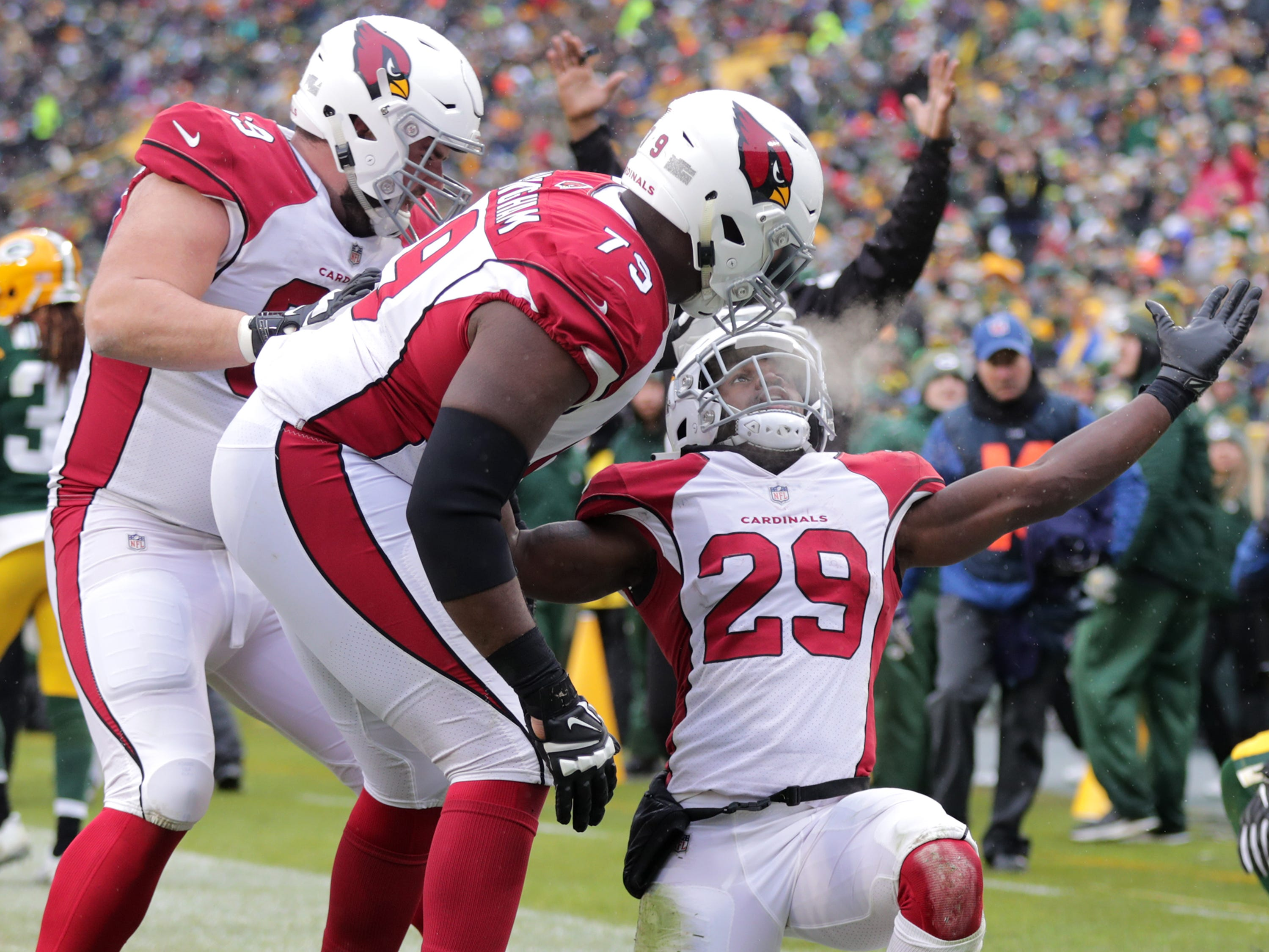 Arizona Cardinals running back Chase Edmonds celebrates a third quarter touchdown against Green Bay Packers inside linebacker Blake Martinez and cornerback Josh Jackson during their football game on Sunday, December 2, 2018, at Lambeau Field in Green Bay, Wis. Wm. Glasheen/USA TODAY NETWORK-Wisconsin.