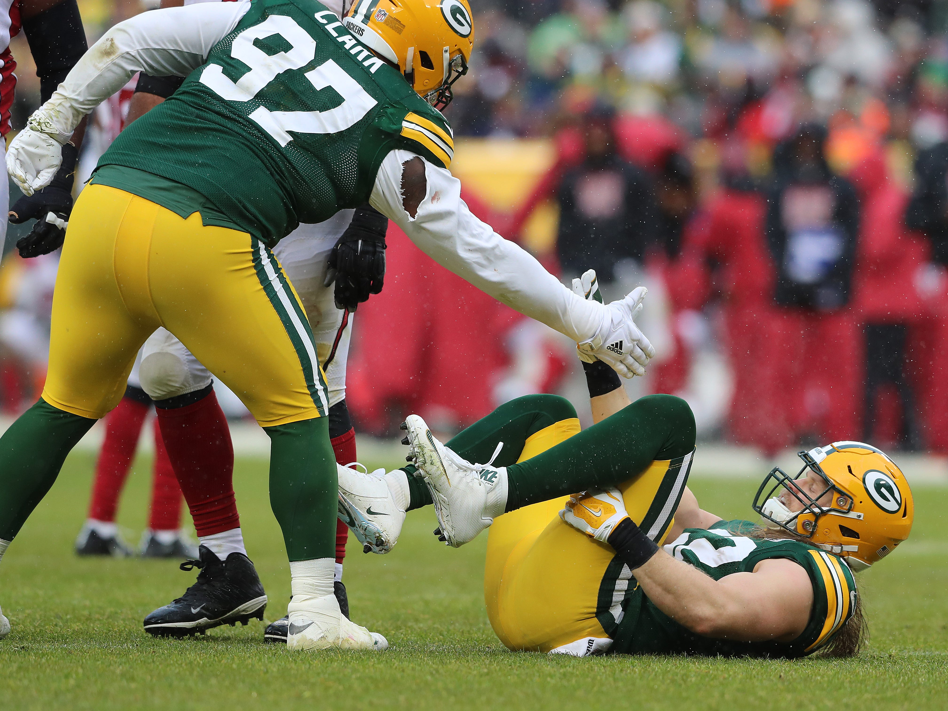 Green Bay Packers outside linebacker Clay Matthews (52)  gets a hand up from nose tackle Kenny Clark (97) against the Arizona Cardinals Sunday, December 2, 2018 at Lambeau Field in Green Bay, Wis. Jim Matthews/USA TODAY NETWORK-Wis