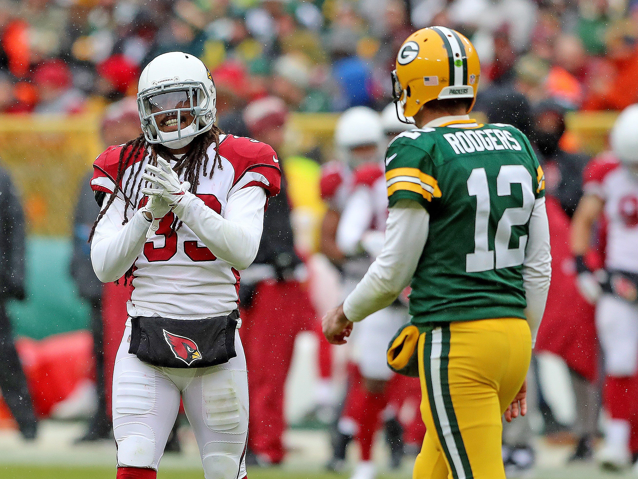 Green Bay Packers quarterback Aaron Rodgers (12) watches as defensive back Tre Boston (33) applauds a third down incompletion against the Arizona Cardinals Sunday, December 2, 2018 at Lambeau Field in Green Bay, Wis. Jim Matthews/USA TODAY NETWORK-Wis