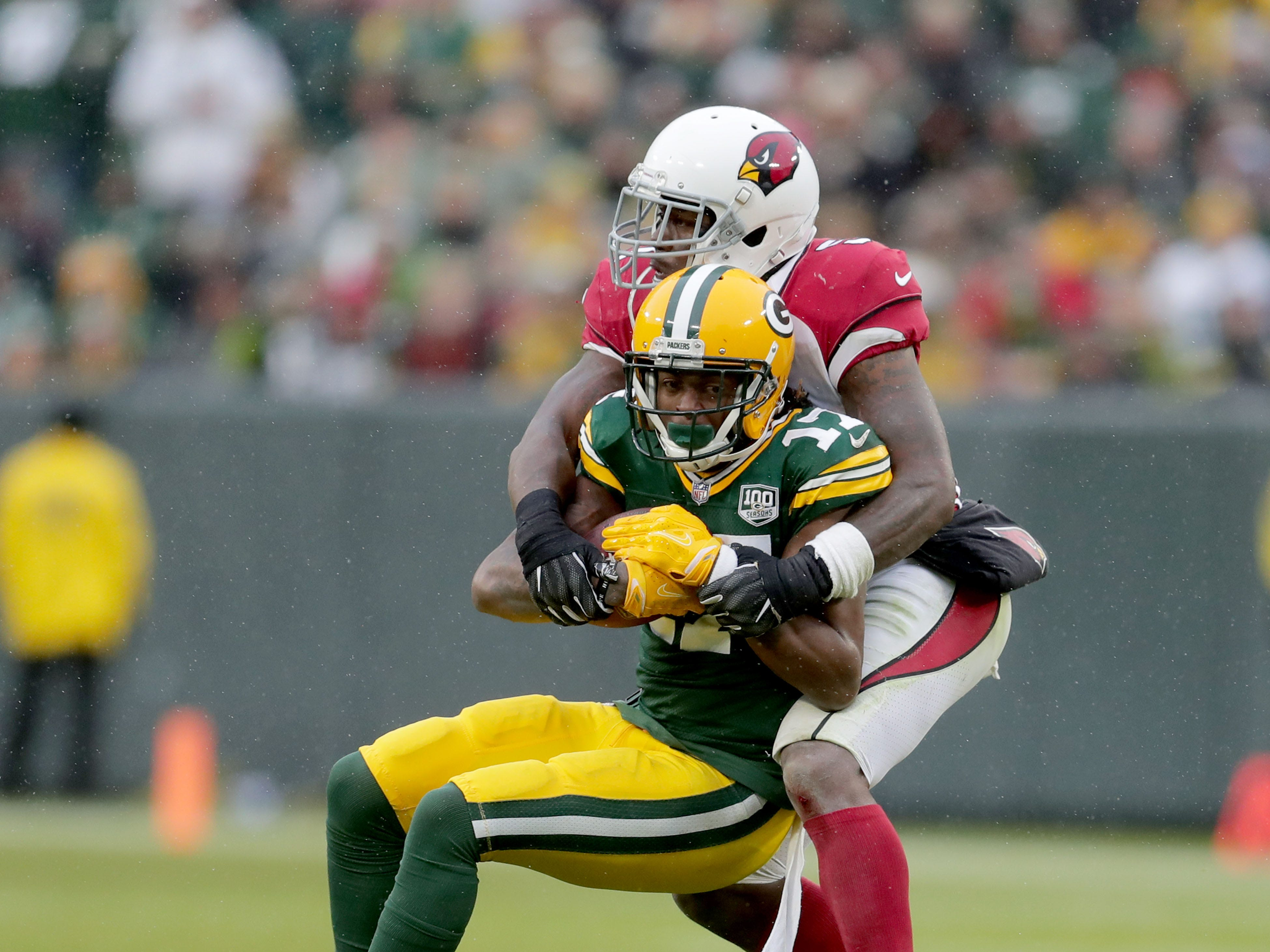 Green Bay Packers wide receiver Davante Adams (17) is tackled by Arizona Cardinals linebacker Gerald Hodges (51) during the 4th quarter of Green Bay Packers game 20-17 loss against the Arizona Cardinals on Sunday, December 2, 2018 at Lambeau Field in Green Bay, Wis. Mike De Sisti / USA TODAY NETWORK-Wis