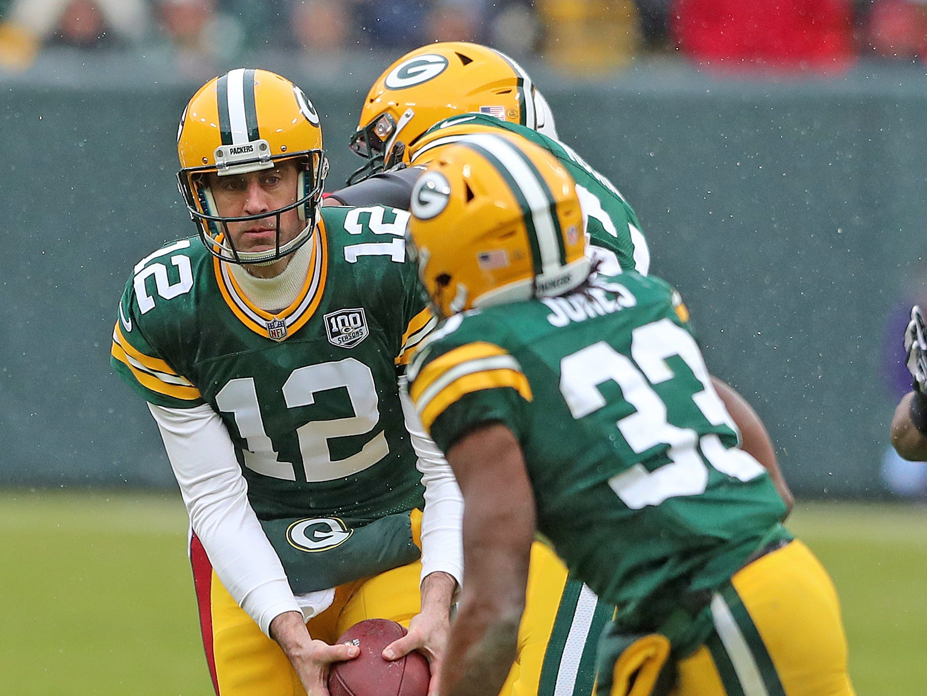 Green Bay Packers quarterback Aaron Rodgers (12) fakes a pitch to running back Aaron Jones (33) against the Arizona Cardinals Sunday, December 2, 2018 at Lambeau Field in Green Bay, Wis. Jim Matthews/USA TODAY NETWORK-Wis