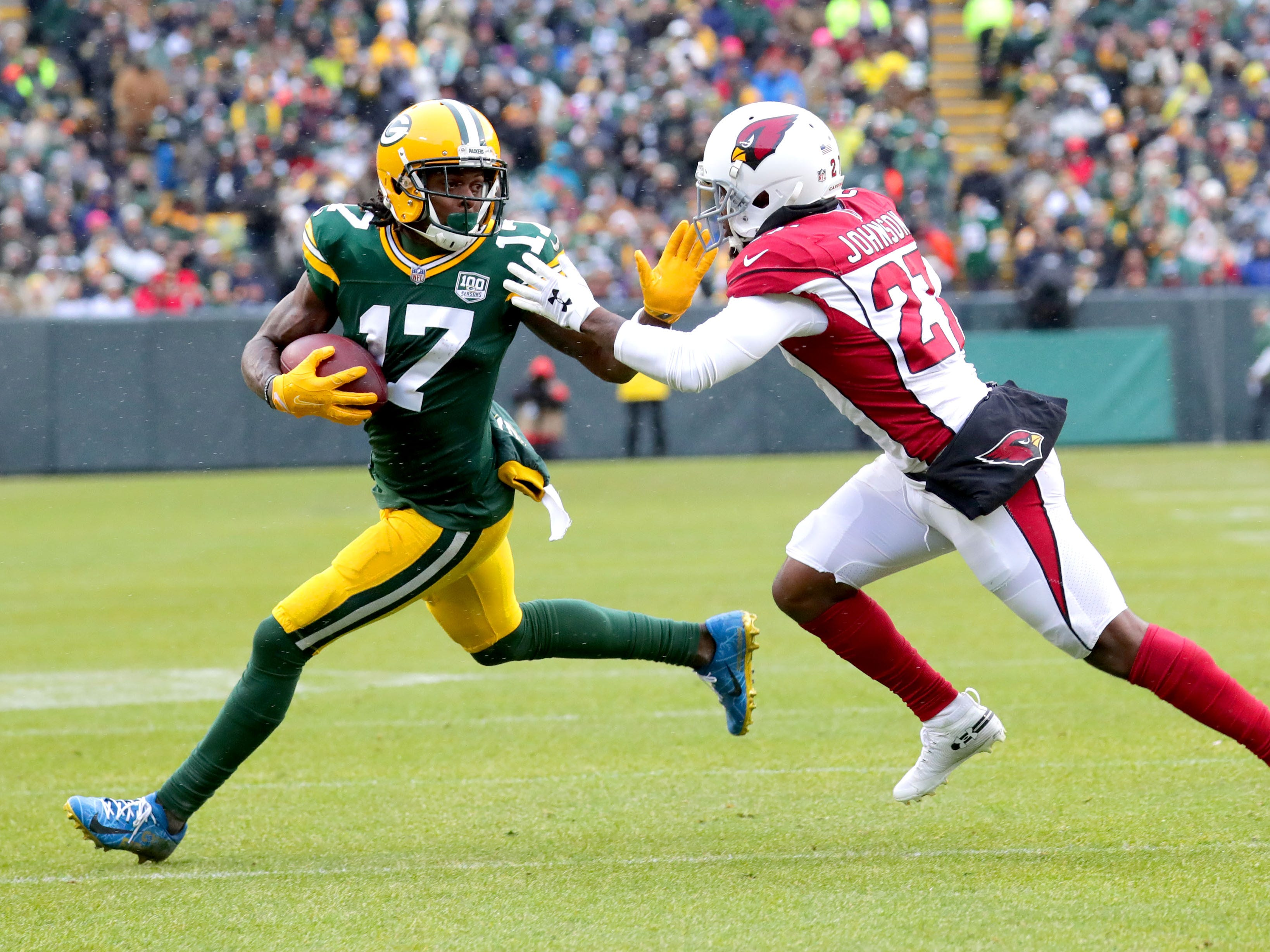 Green Bay Packers wide receiver Davante Adams (17) fights off Arizona Cardinals defensive back Leonard Johnson (27) after making a catch during the 2nd quarter of Green Bay Packers game against the Arizona Cardinals game Sunday, December 2, 2018 at Lambeau Field in Green Bay, Wis. Mike De Sisti / USA TODAY NETWORK-Wis