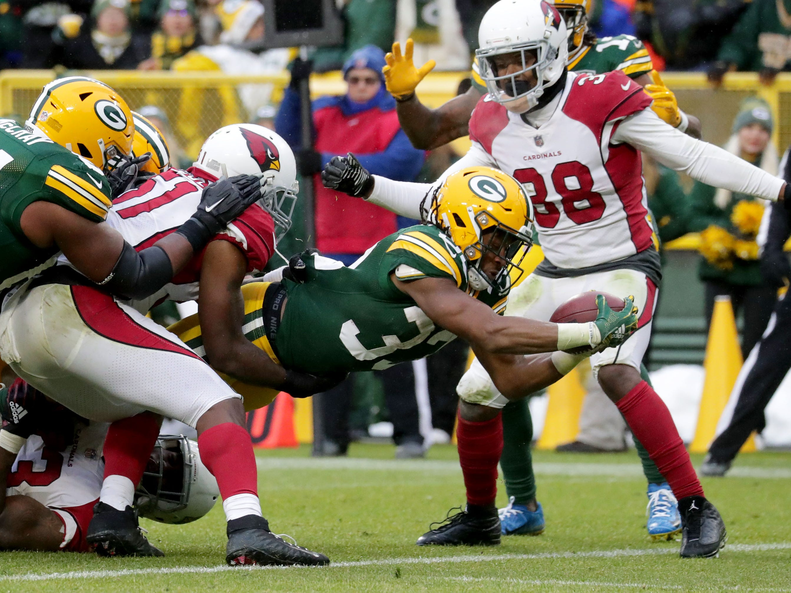 Green Bay Packers running back Aaron Jones (33) scores a touchdown during the 4th quarter of Green Bay Packers game 20-17 loss against the Arizona Cardinals on Sunday, December 2, 2018 at Lambeau Field in Green Bay, Wis. Mike De Sisti / USA TODAY NETWORK-Wis