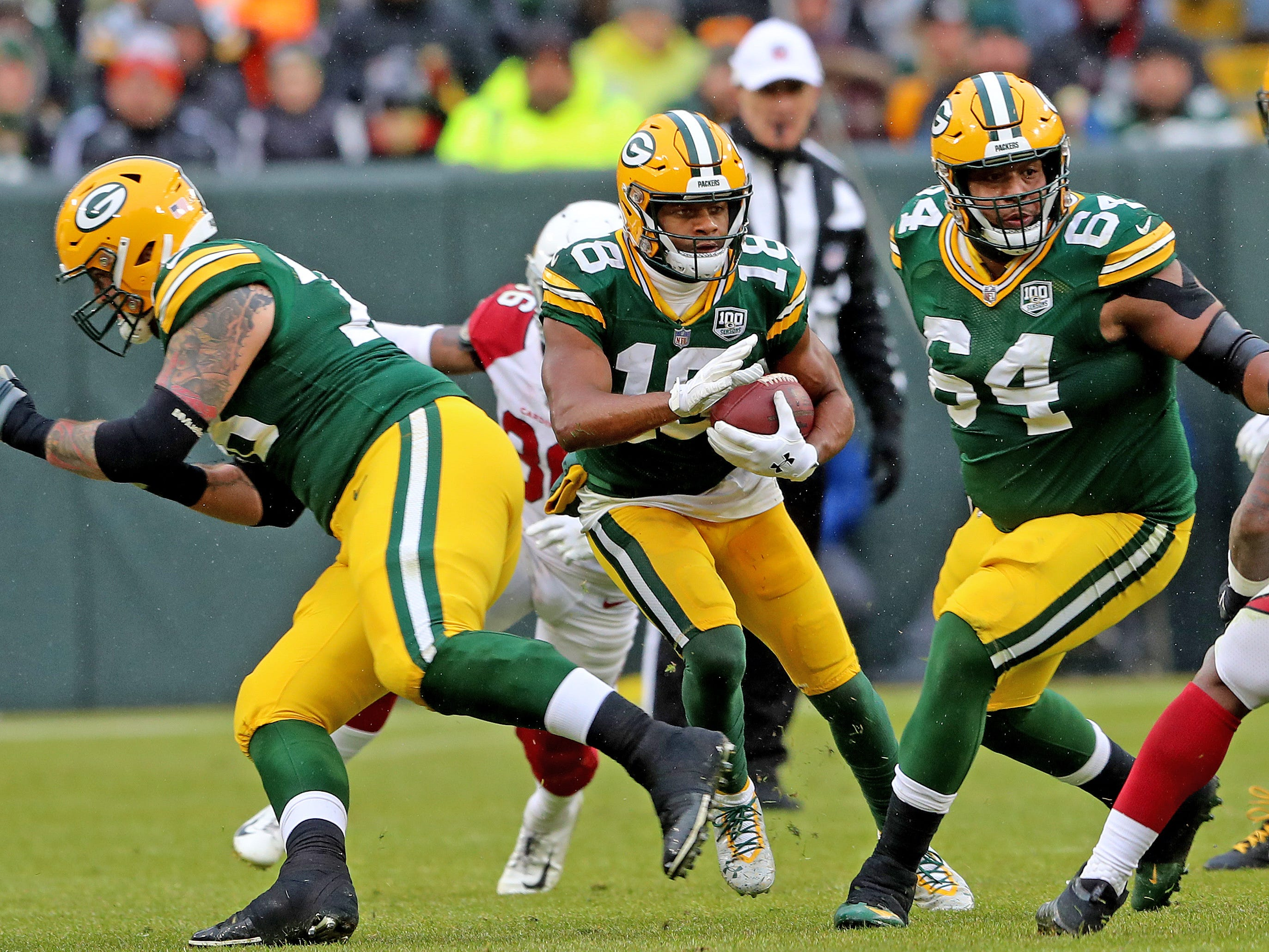Green Bay Packers wide receiver Randall Cobb (18) runs after a catch as offensive tackle Jason Spriggs (78) and offensive guard Justin McCray (64) block against the Arizona Cardinals Sunday, December 2, 2018 at Lambeau Field in Green Bay, Wis. Jim Matthews/USA TODAY NETWORK-Wis