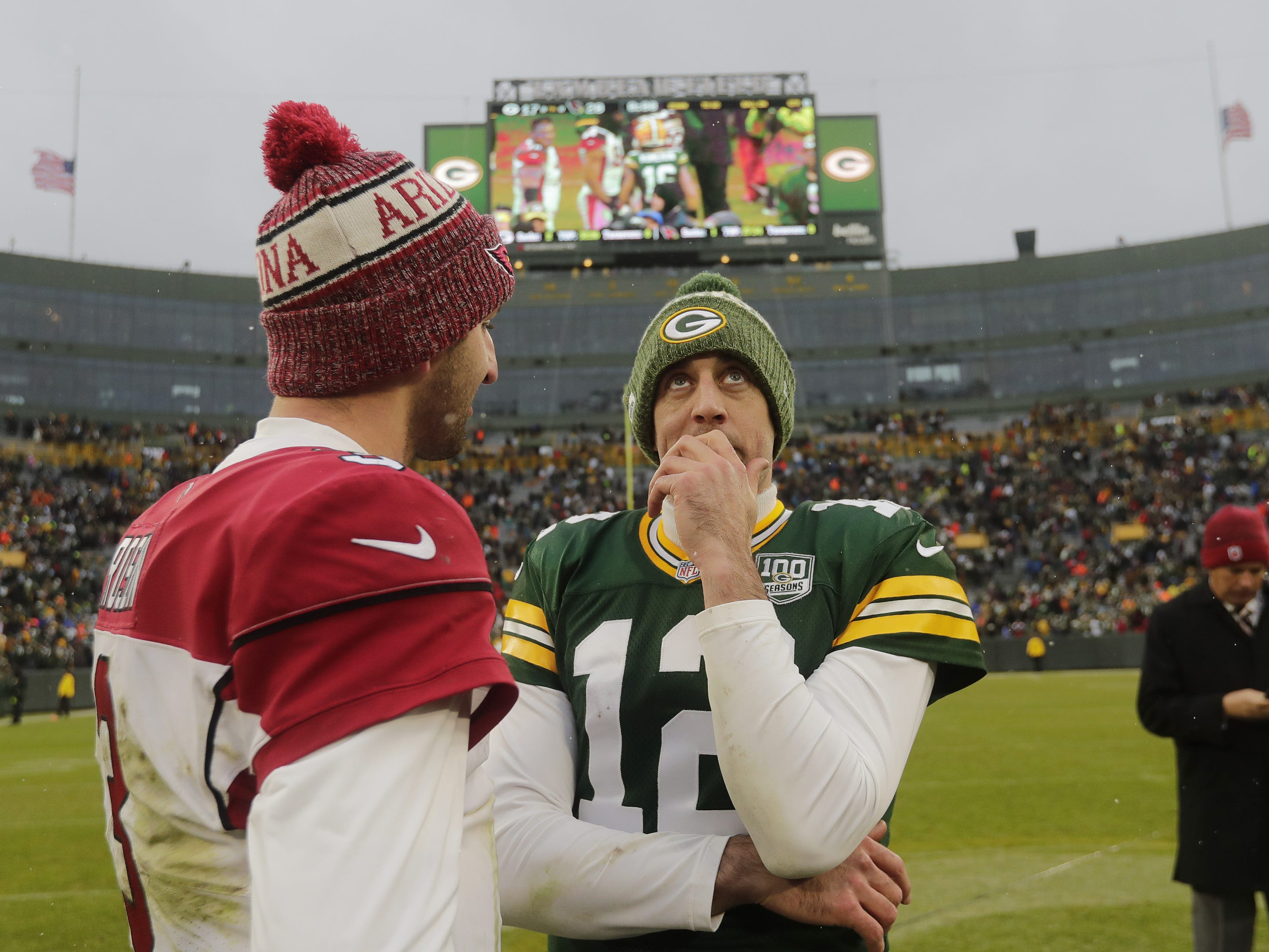 Green Bay Packers quarterback Aaron Rodgers (12) talks with Arizona Cardinals quarterback Josh Rosen (3) after the Cardinals defeated the Packers at Lambeau Field on Sunday, December 2, 2018 in Green Bay, Wis.