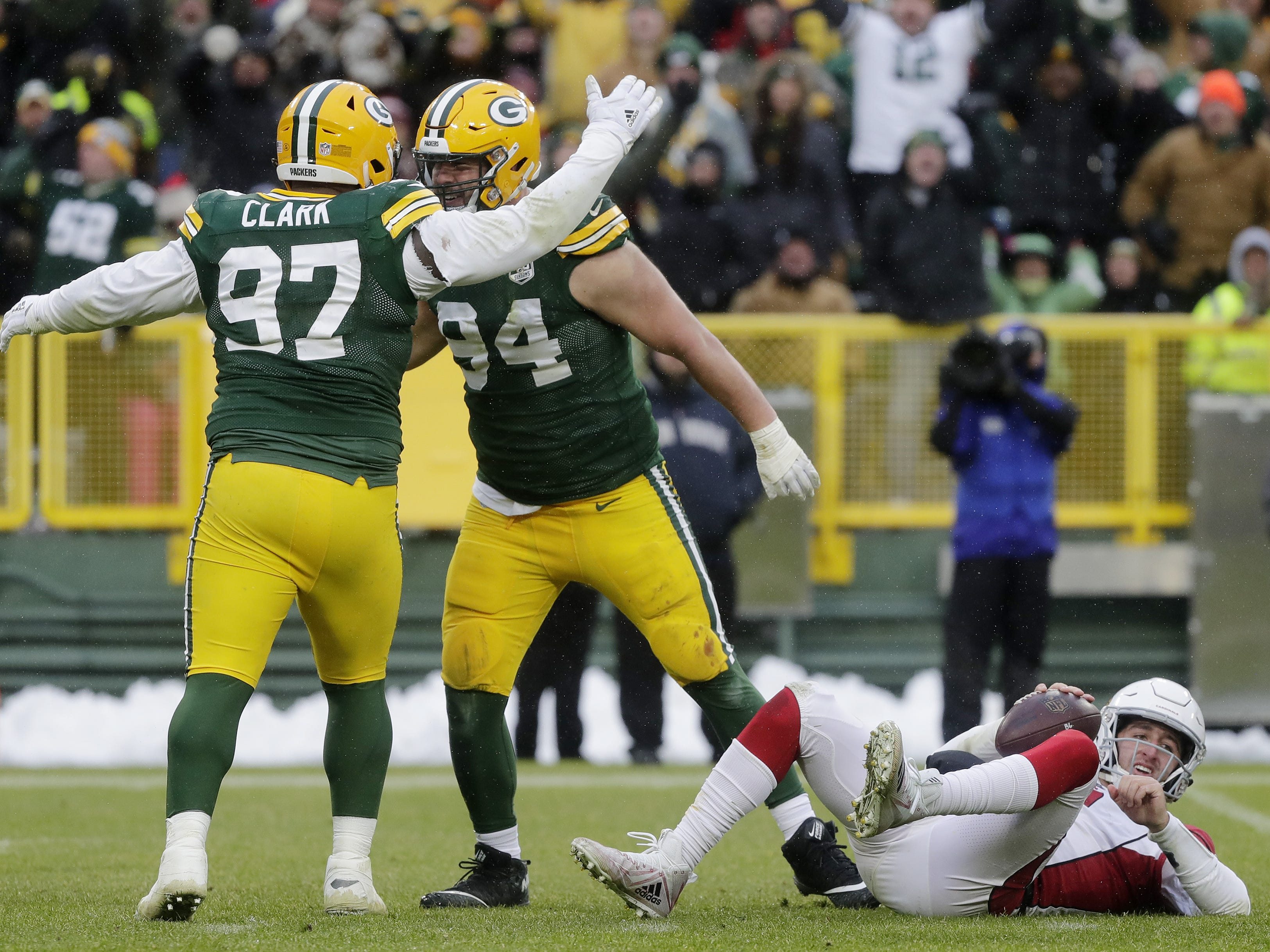 Green Bay Packers defensive end Dean Lowry (94) celebrates with nose tackle Kenny Clark (97) after sacking Arizona Cardinals quarterback Josh Rosen (3) in the fourth quarter at Lambeau Field on Sunday, December 2, 2018 in Green Bay, Wis.