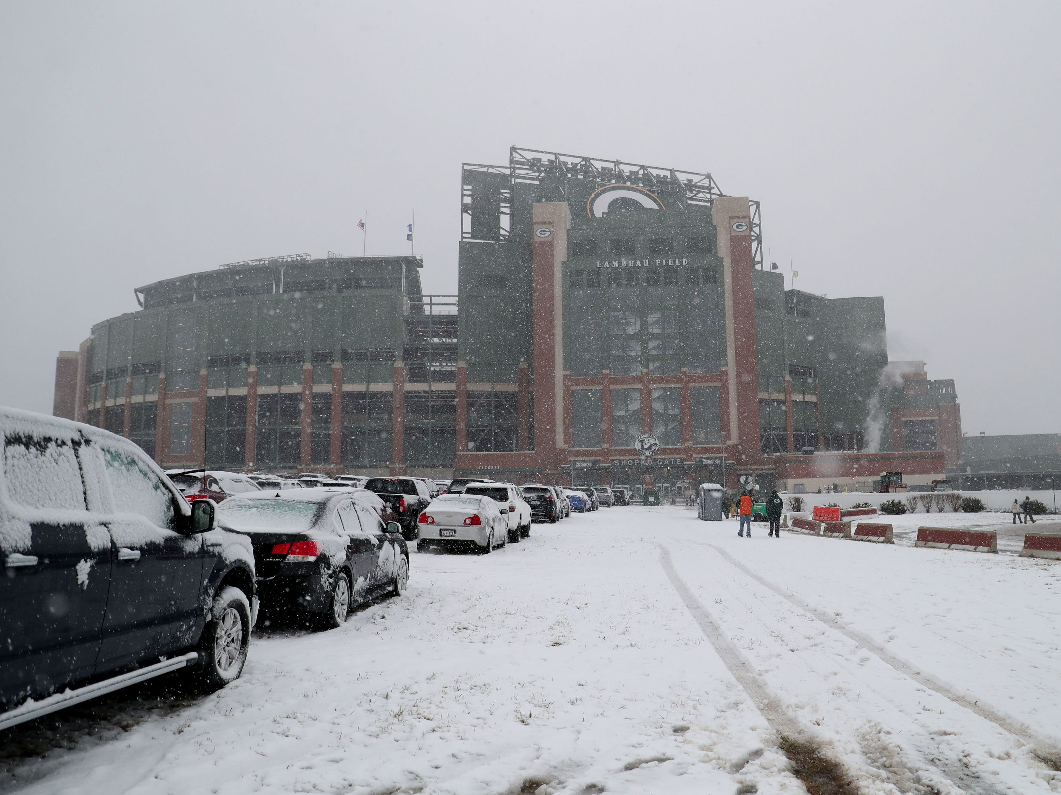 Snow falls over Lambeau Field before the Green Bay Packers game against the Arizona Cardinals at Lambeau Field in Green Bay, Wis. on Sunday, December 2, 2018.
