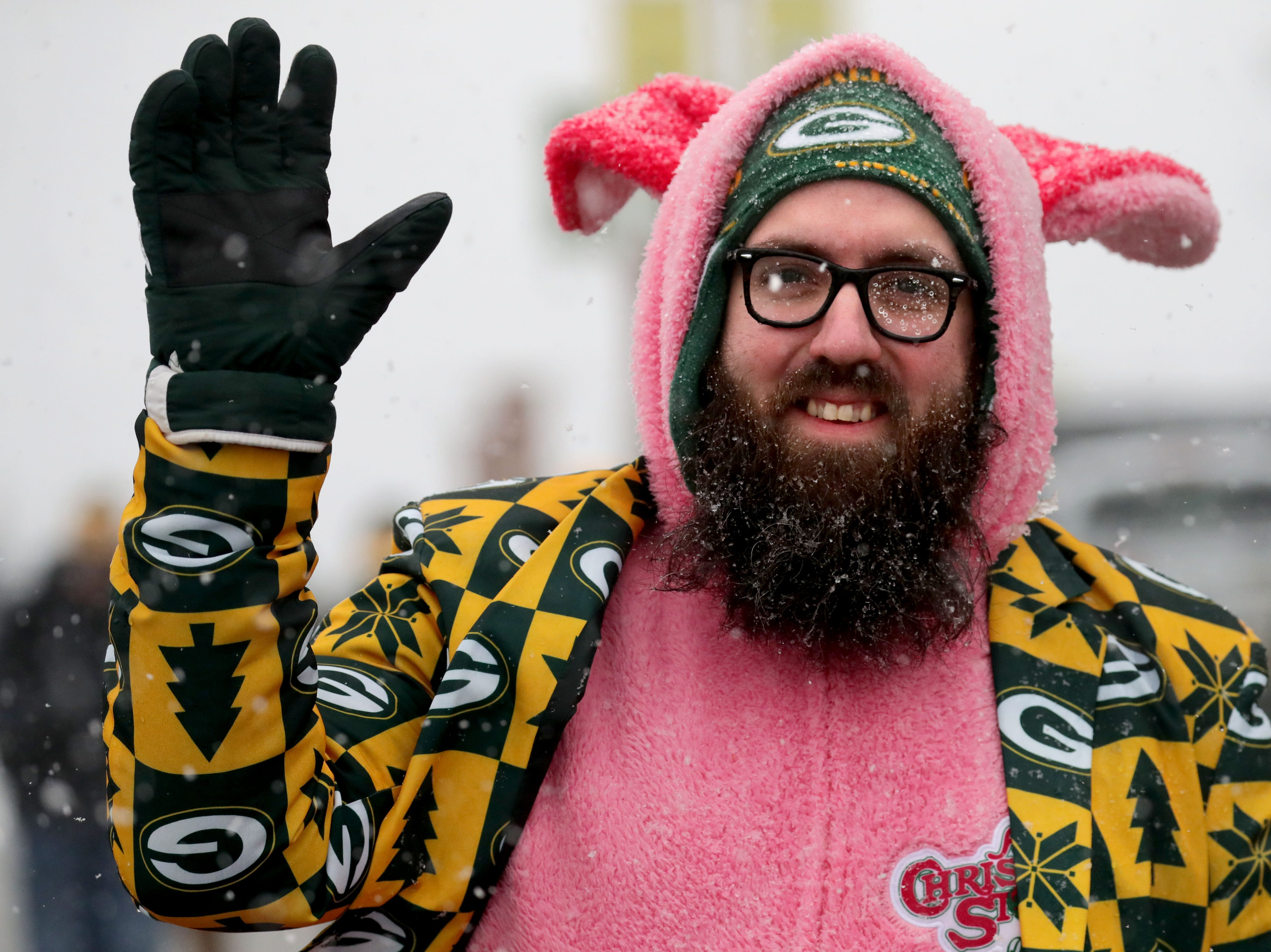 """Mike Goodman from Fort Wayne, Ind. waves as he's dressed as Ralphie's bunny costume from the movie """"A Christmas Story"""" while tailgating before the Green Bay Packers game against the Arizona Cardinals at Lambeau Field in Green Bay, Wis. on Sunday, December 2, 2018."""