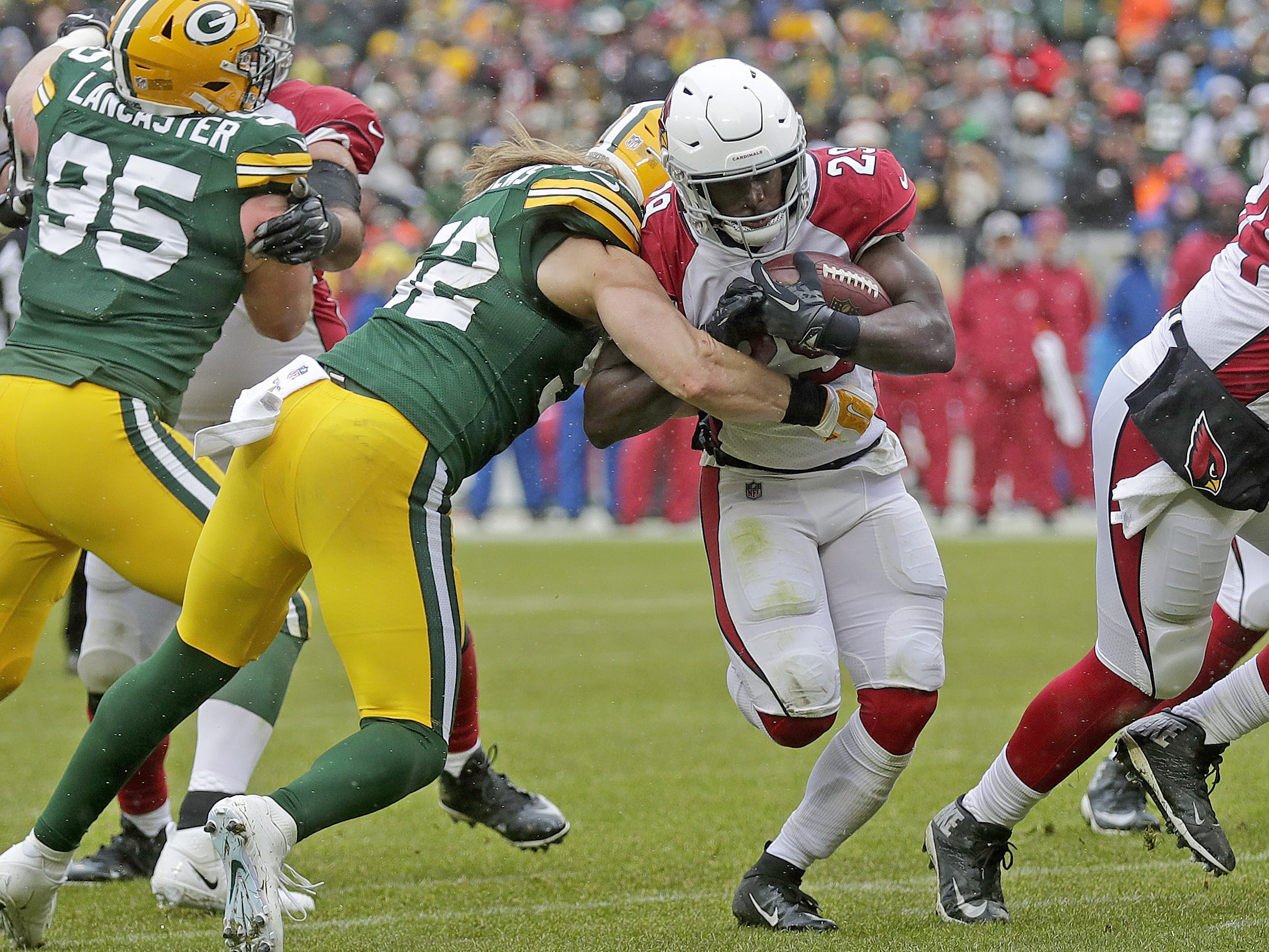 Green Bay Packers outside linebacker Clay Matthews (52) hits but can't stop running back Chase Edmonds (29) from scoring a touchdown in the second quarter against the Arizona Cardinals Sunday, December 2, 2018 at Lambeau Field in Green Bay, Wis. Jim Matthews/USA TODAY NETWORK-Wis