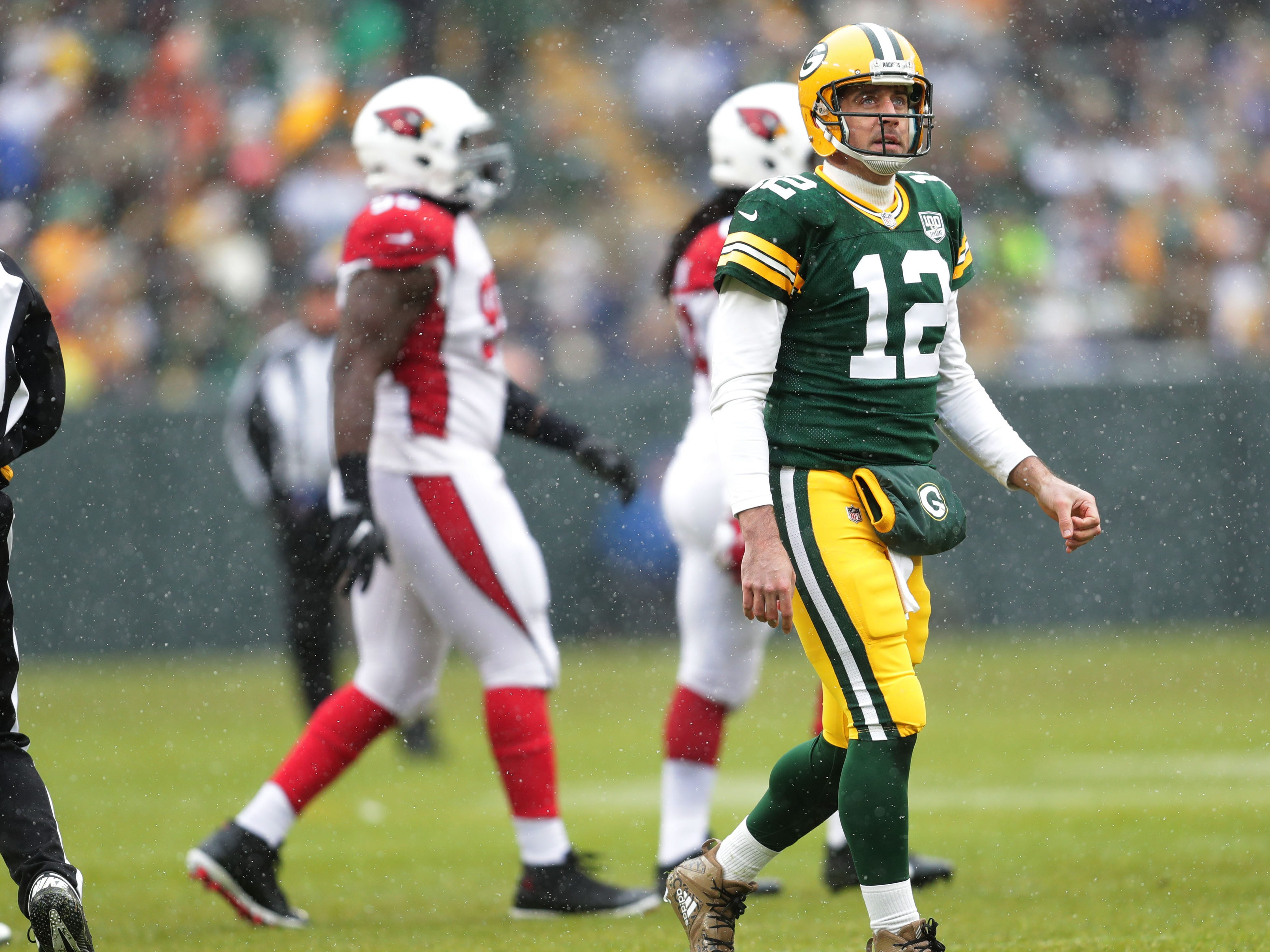 Green Bay Packers quarterback Aaron Rodgers (12) walks off the field after a not converting on 3rd down during the 1st quarter of Green Bay Packers game against the Arizona Cardinals game Sunday, December 2, 2018 at Lambeau Field in Green Bay, Wis. Mike De Sisti / USA TODAY NETWORK-Wis