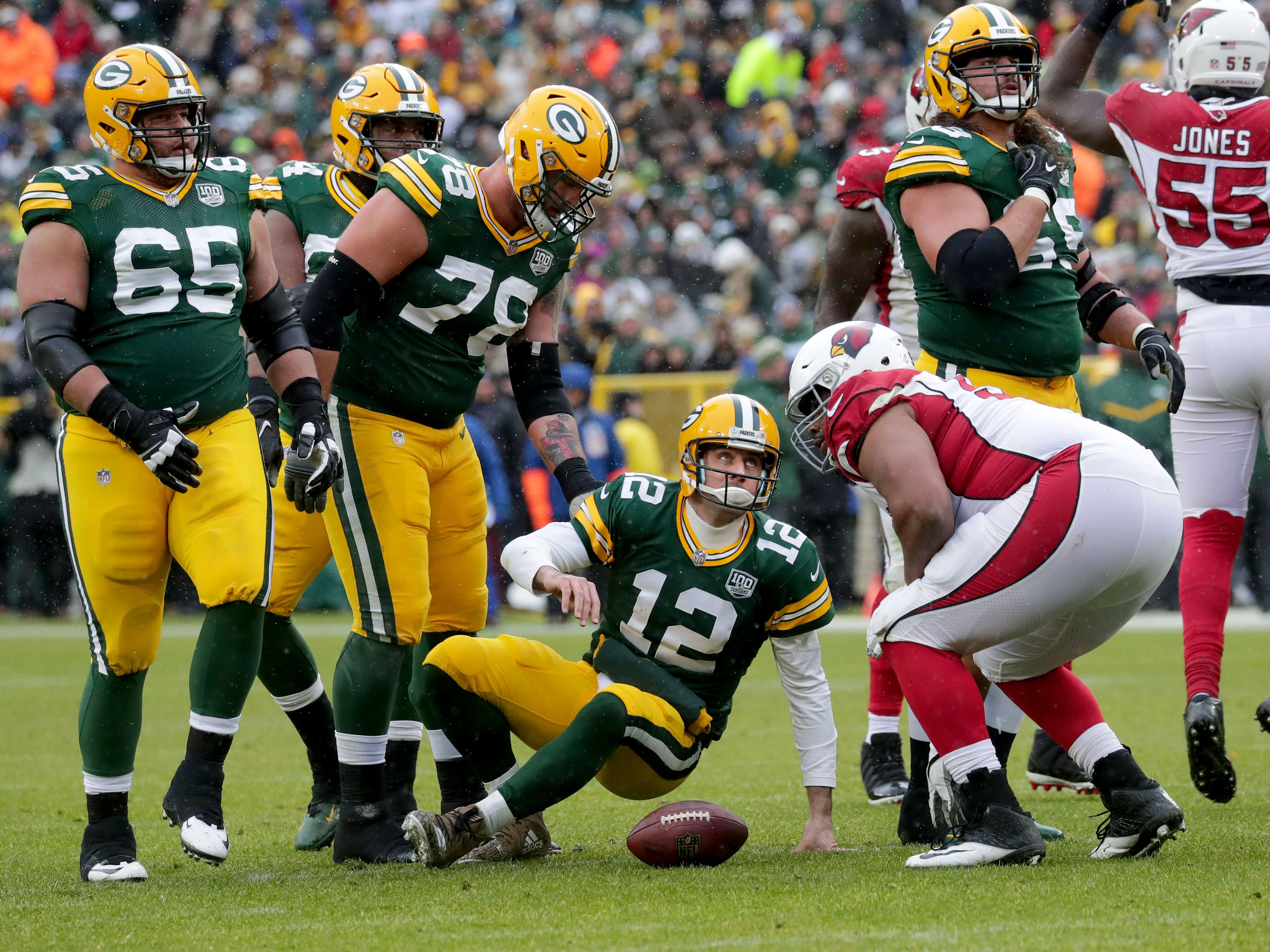 Green Bay Packers quarterback Aaron Rodgers (12) gets up after being sacked during the 2nd quarter of Green Bay Packers game against the Arizona Cardinals game Sunday, December 2, 2018 at Lambeau Field in Green Bay, Wis. Mike De Sisti / USA TODAY NETWORK-Wis