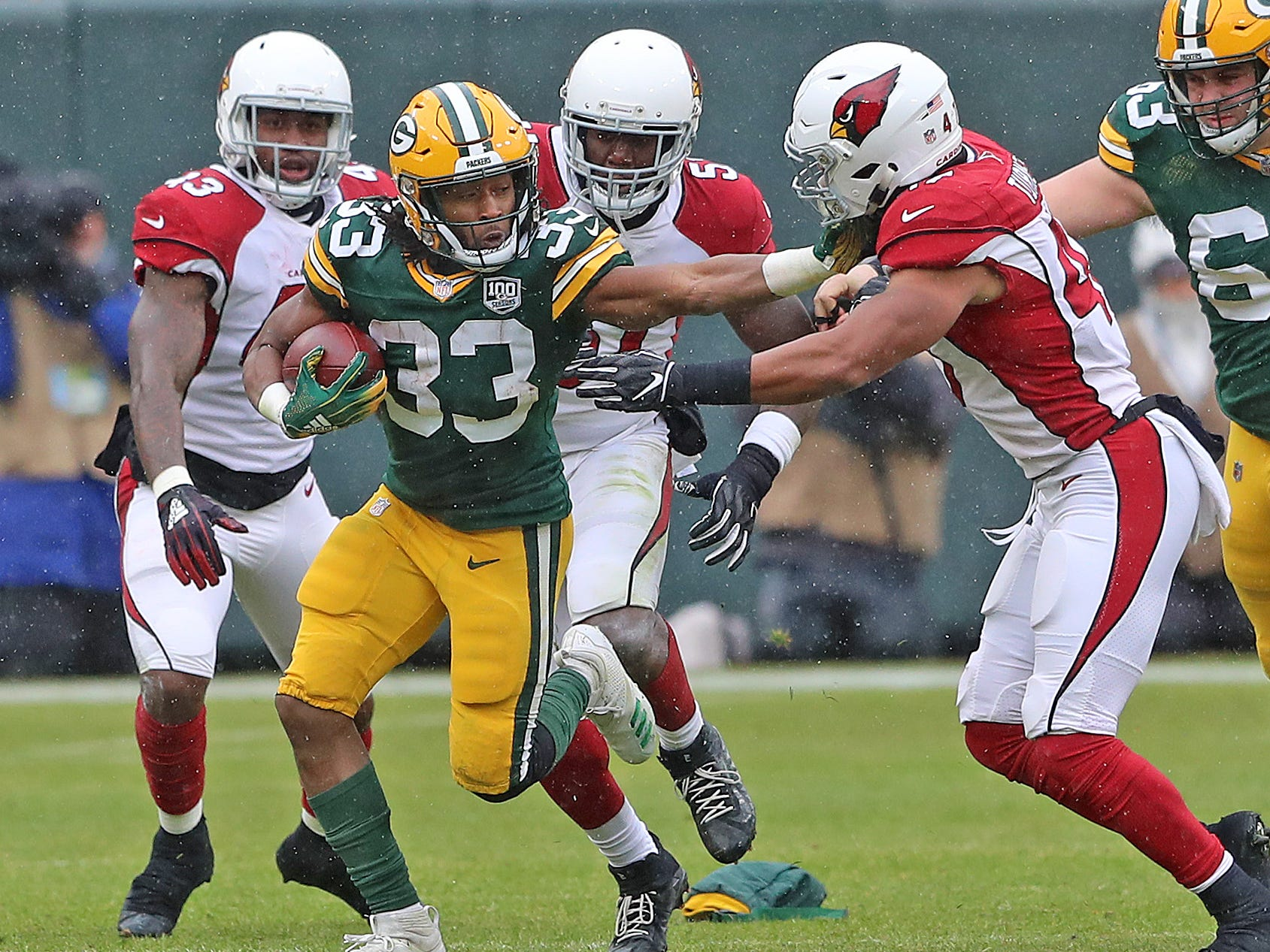 Green Bay Packers running back Aaron Jones (33) runs away from the defense against the Arizona Cardinals Sunday, December 2, 2018 at Lambeau Field in Green Bay, Wis. Jim Matthews/USA TODAY NETWORK-Wis