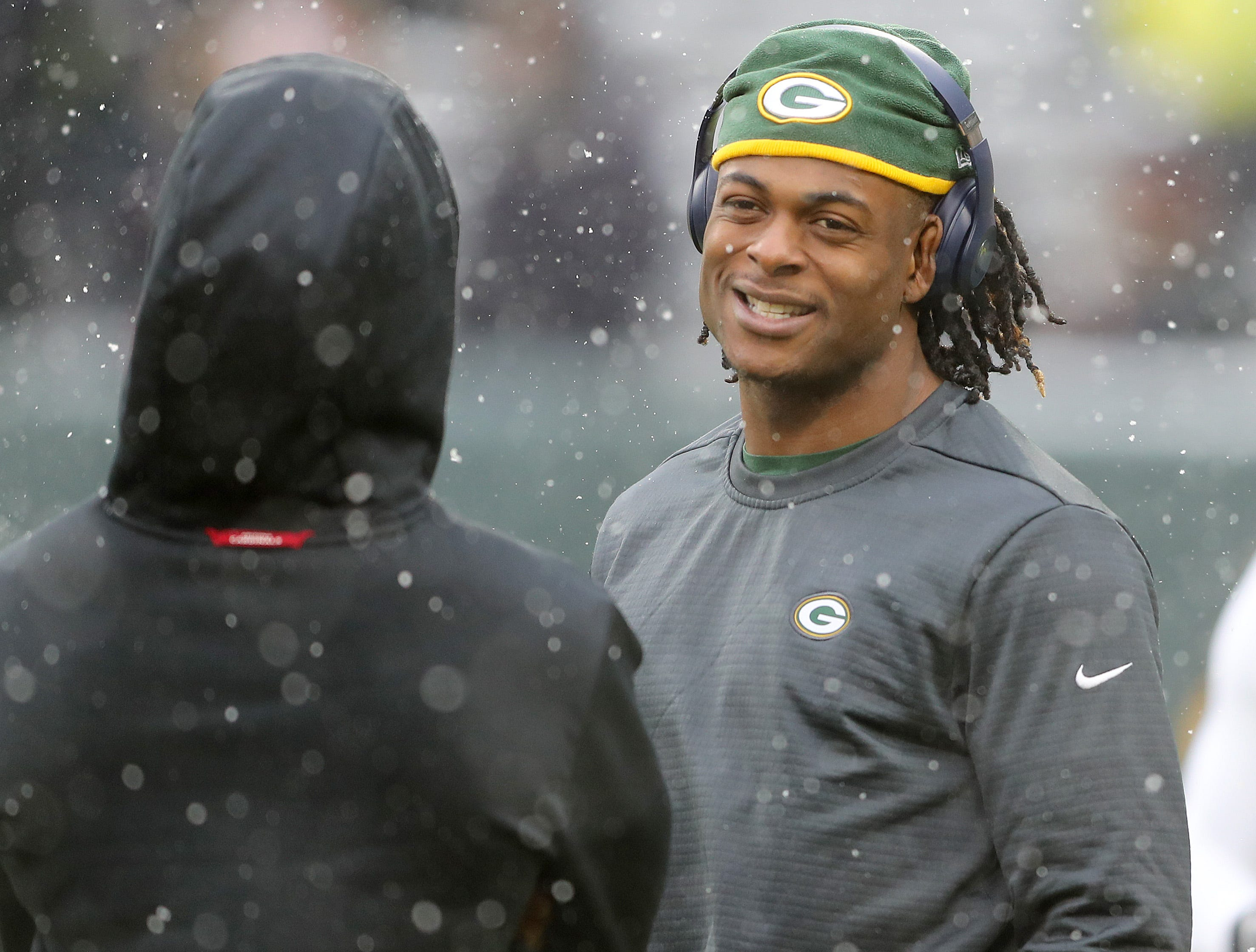 Green Bay Packers wide receiver Davante Adams (17) walks with a friend before the game against the Arizona Cardinals Sunday, December 2, 2018 at Lambeau Field in Green Bay, Wis.