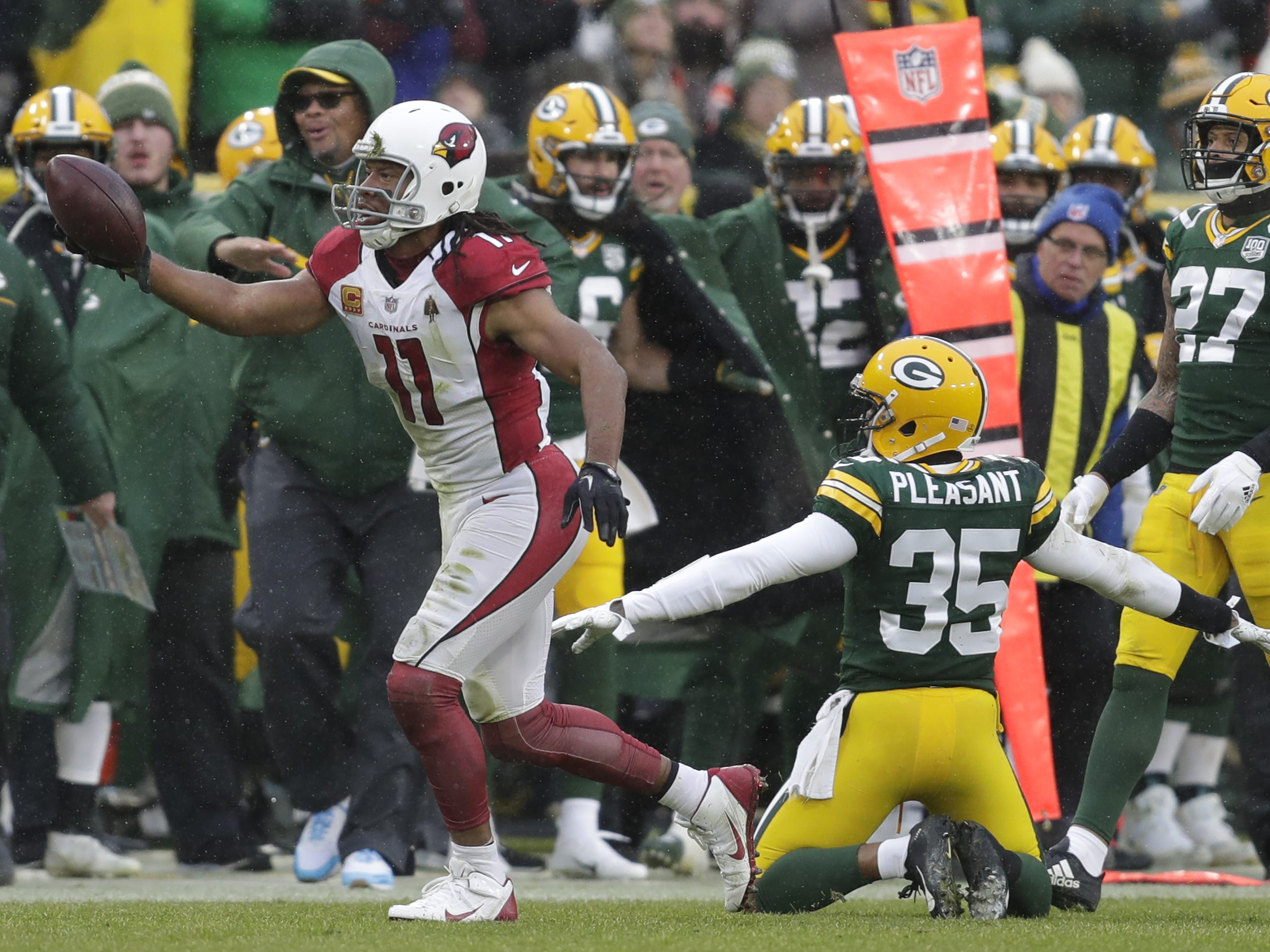 Arizona Cardinals wide receiver Larry Fitzgerald (11) celebrates a long receptiion in the fourth quarter against Green Bay Packers defensive back Eddie Pleasant (35) and cornerback Josh Jackson (37) Sunday, December 2, 2018, at Lambeau Field in Green Bay, Wis.  Dan Powers/USA TODAY NETWORK-Wisconsin