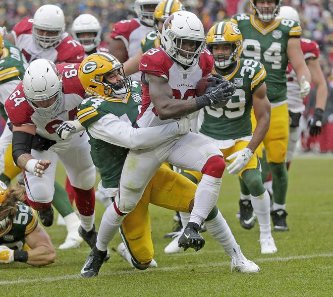 Green Bay Packers inside linebacker Antonio Morrison (44) is carried into the end zone by Arizona Cardinals running back Chase Edmonds (29) against the Arizona Cardinals Sunday, December 2, 2018 at Lambeau Field in Green Bay, Wis. Jim Matthews/USA TODAY NETWORK-Wis