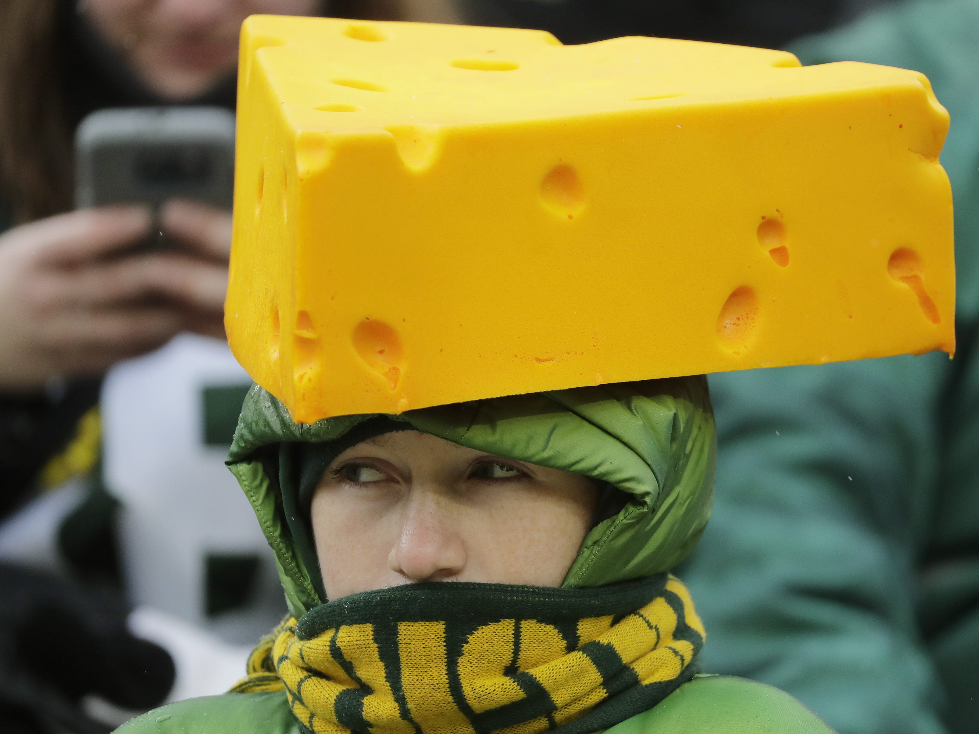 A Green Bay Packers fan watches the fourth quarter against the Arizona Cardinals at Lambeau Field on Sunday, December 2, 2018 in Green Bay, Wis.