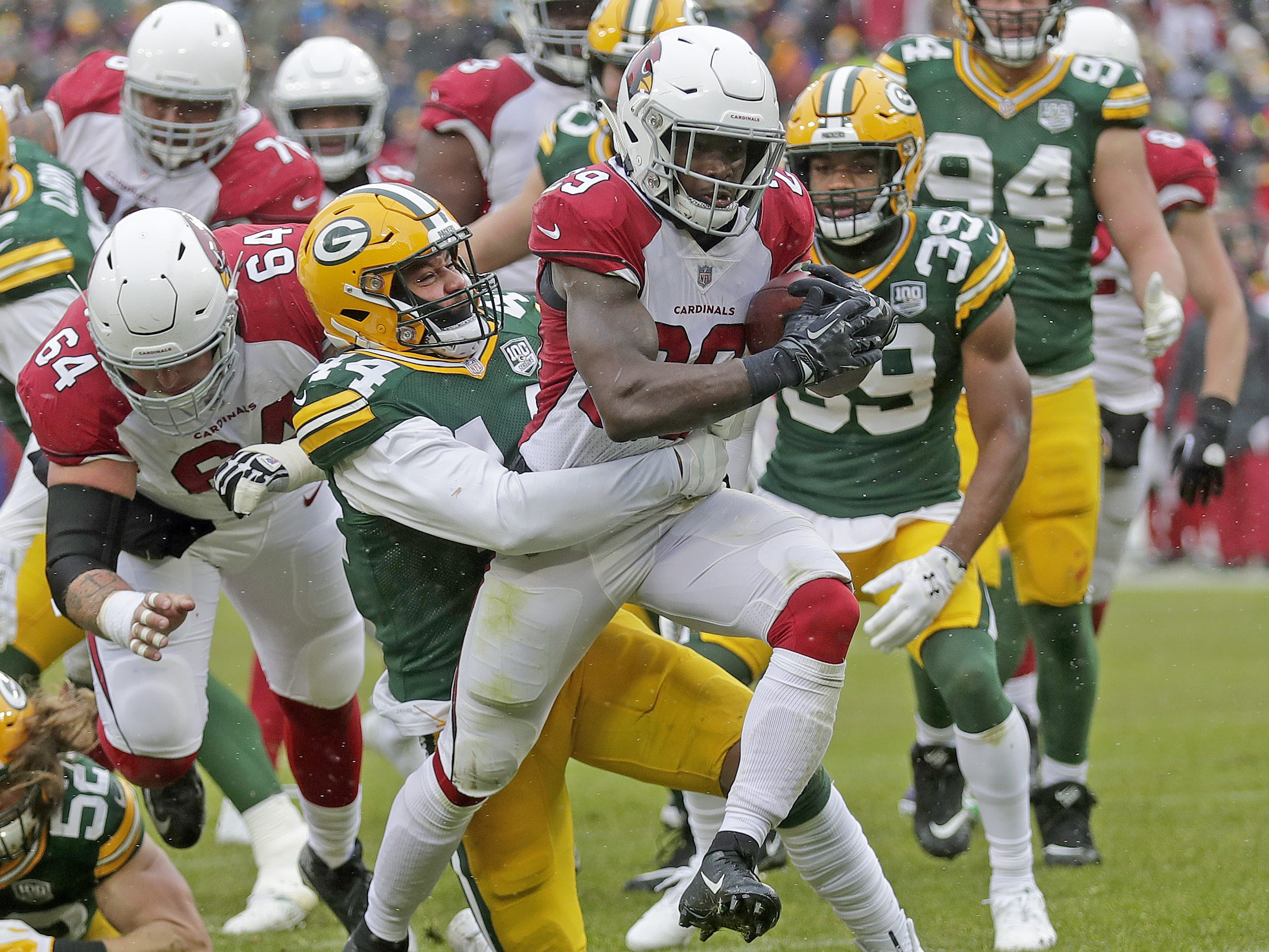 Green Bay Packers inside linebacker Antonio Morrison (44) is carried into the end zone by Arizona Cardinals running back Chase Edmonds (29)against the Arizona Cardinals Sunday, December 2, 2018 at Lambeau Field in Green Bay, Wis. Jim Matthews/USA TODAY NETWORK-Wis