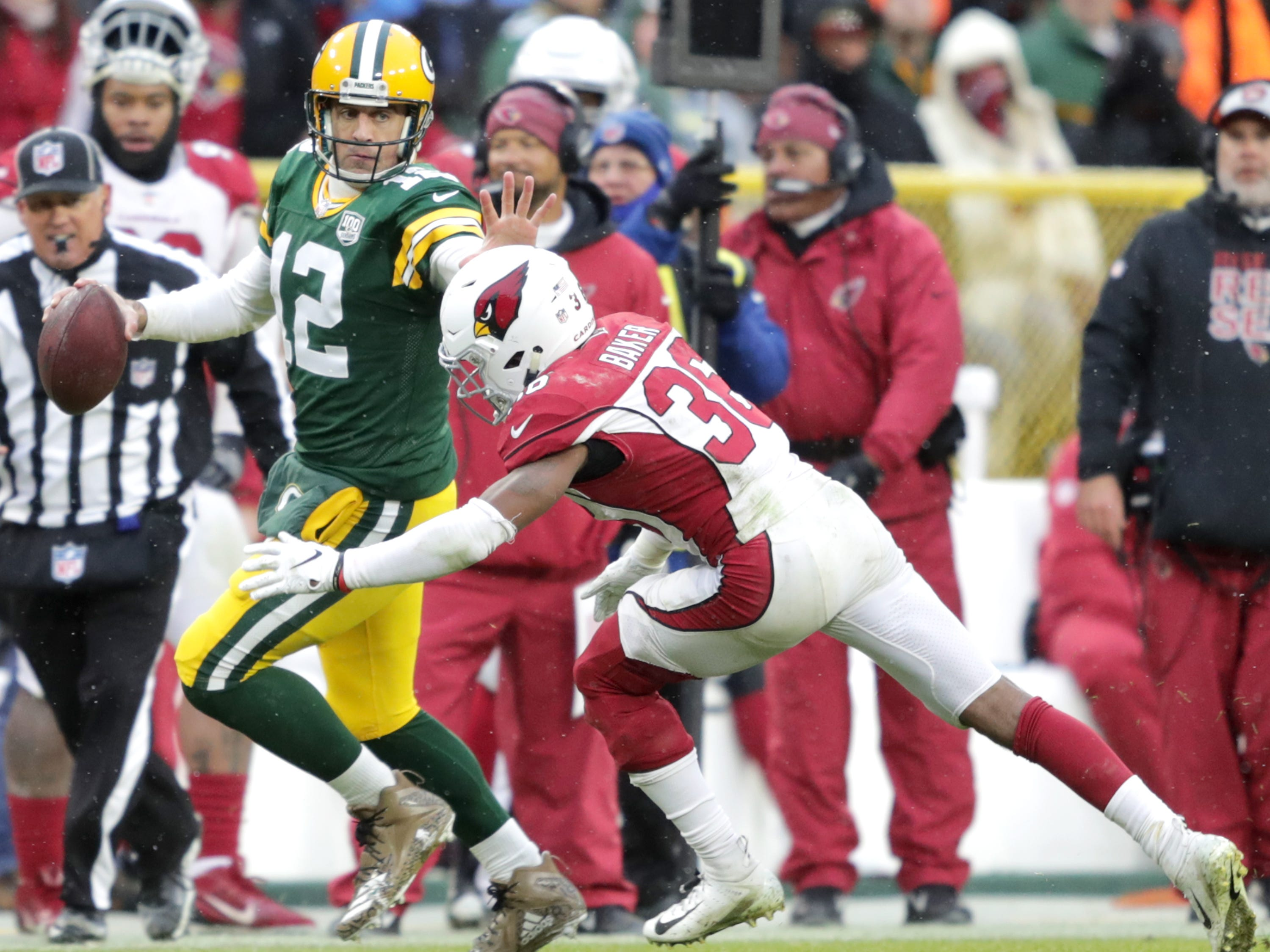 Green Bay Packers quarterback Aaron Rodgers rushes against Arizona Cardinals strong safety Budda Baker during their football game on Sunday, December 2, 2018, at Lambeau Field in Green Bay, Wis. Arizona defeated Green Bay 20 to 17. Wm. Glasheen/USA TODAY NETWORK-Wisconsin.