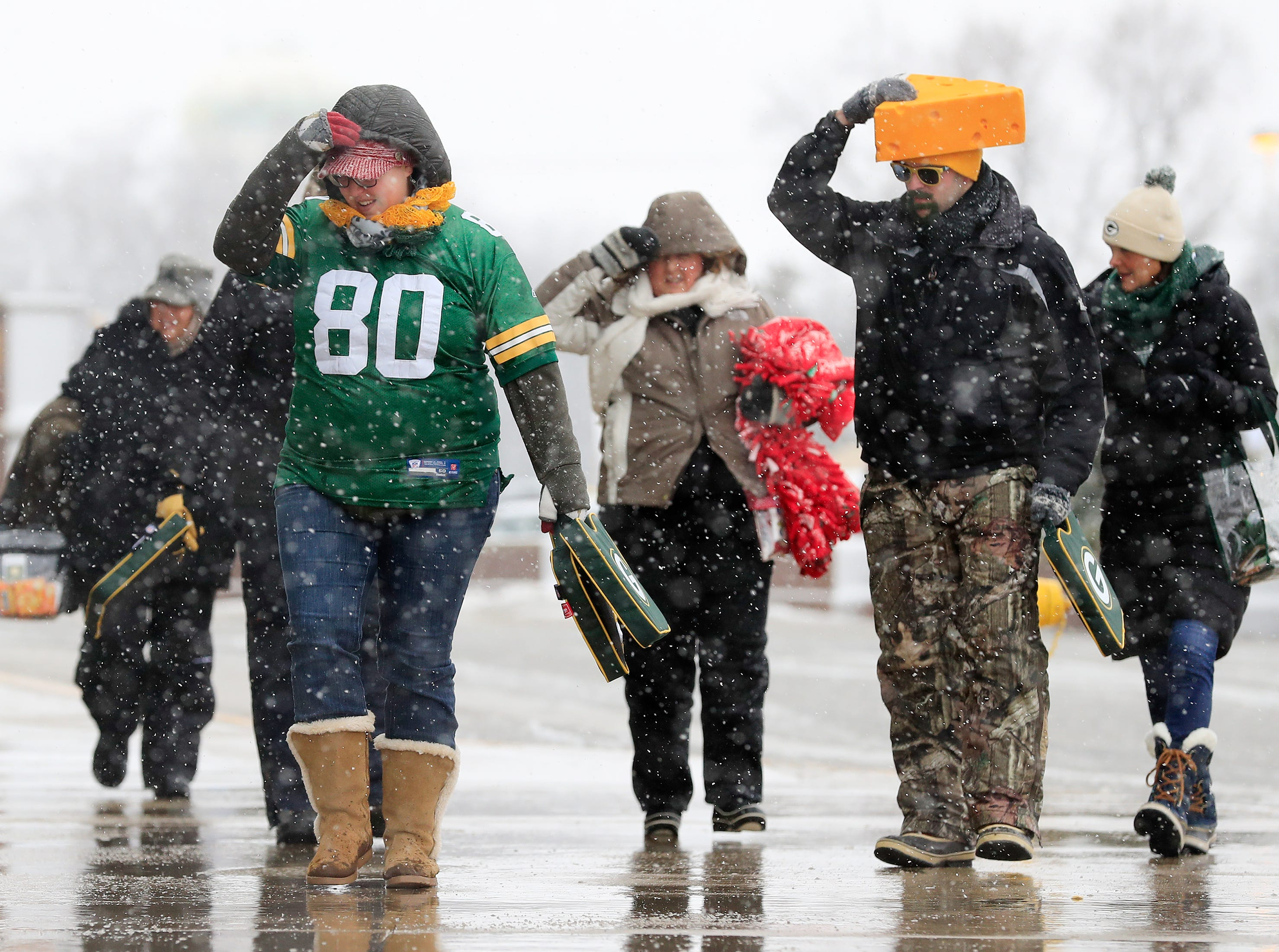 Fans arrive for the Green Bay Packers game against the Arizona Cardinals at Lambeau Field on Sunday, December 2, 2018 in Green Bay, Wis.