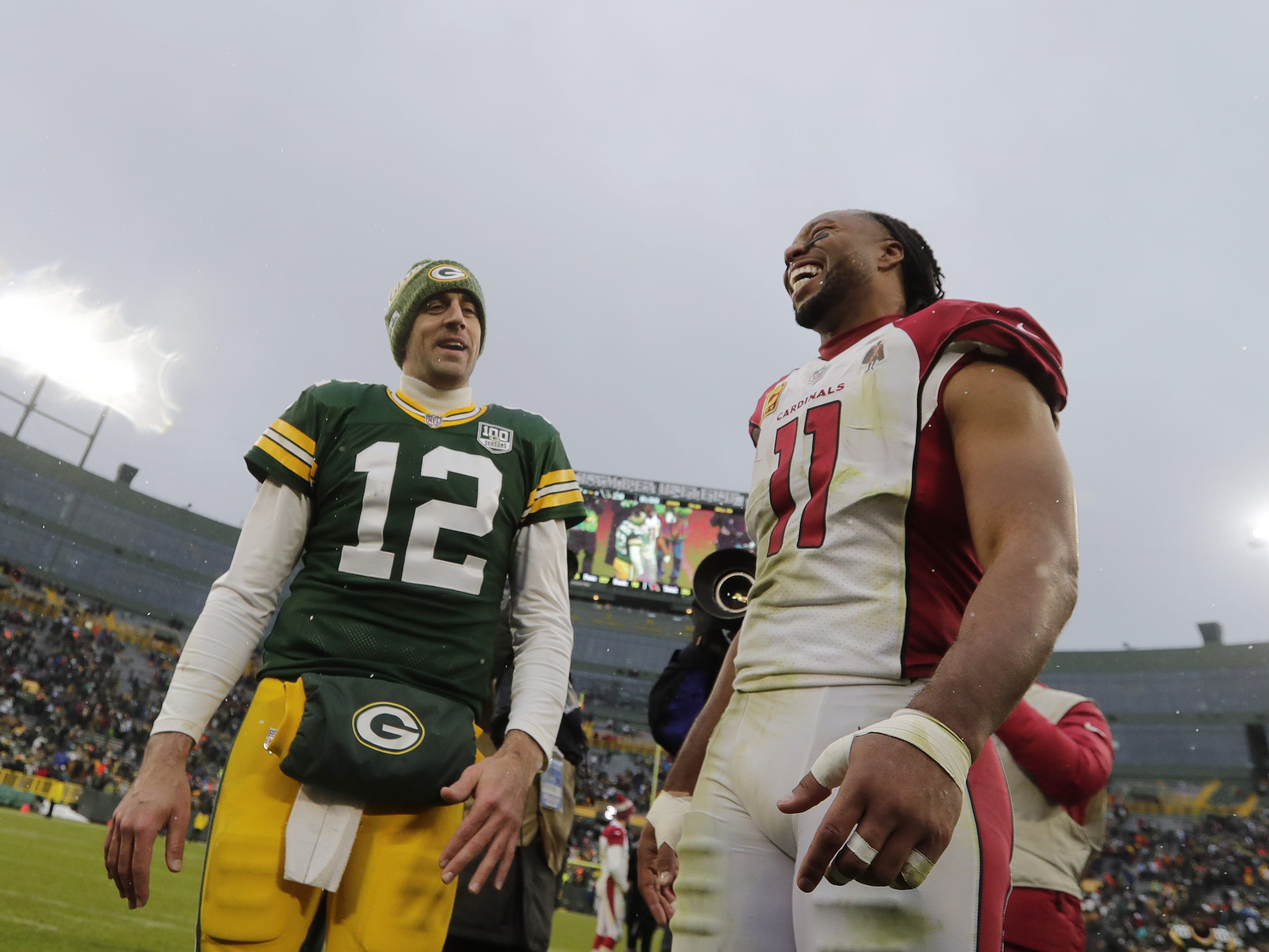 Green Bay Packers quarterback Aaron Rodgers (12) talks with Arizona Cardinals wide receiver Larry Fitzgerald (11) after the Cardinals defeated the Packers at Lambeau Field on Sunday, December 2, 2018 in Green Bay, Wis.