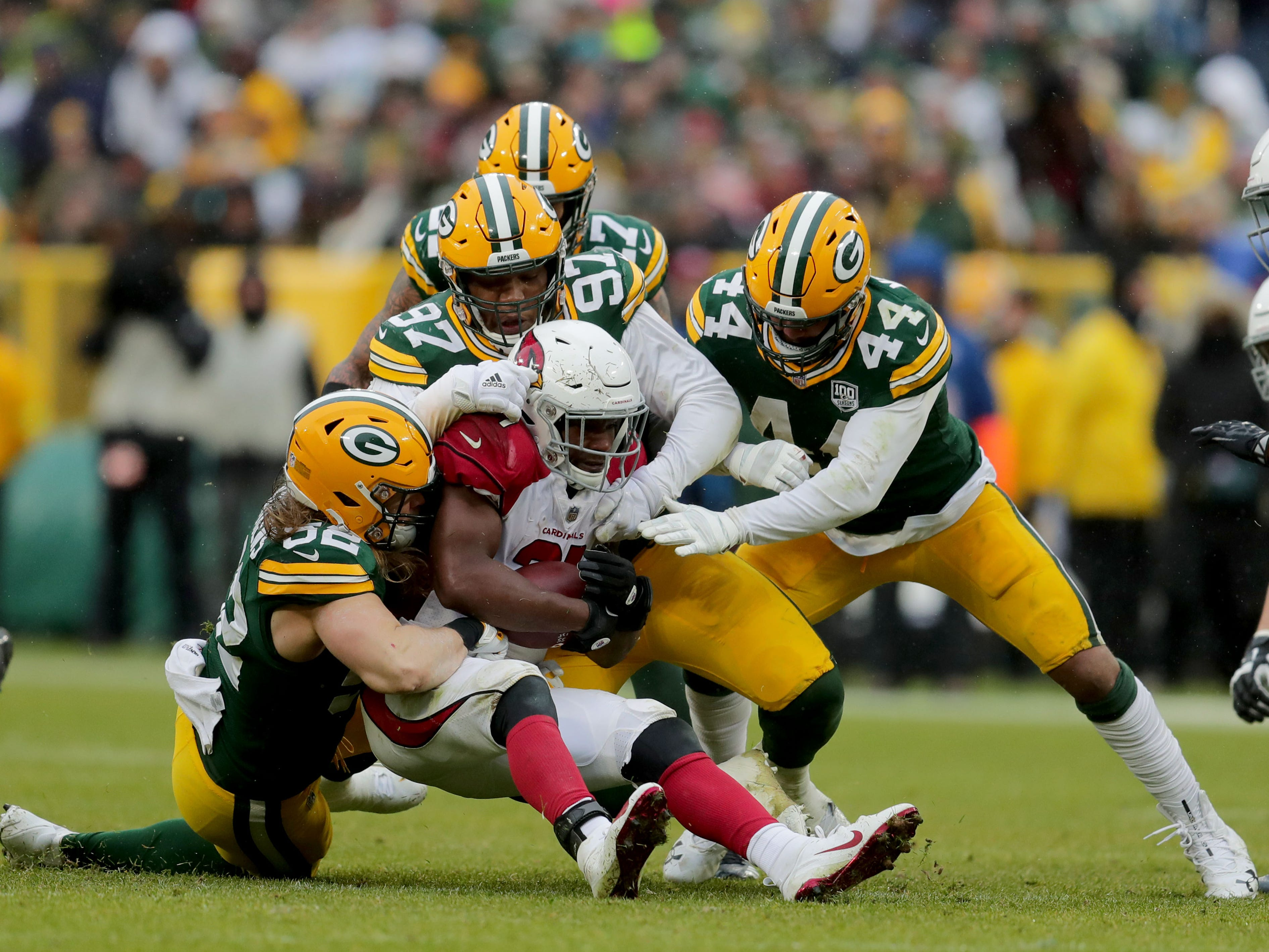 Green Bay Packers defenders tackle Arizona Cardinals running back D.J. Foster (37) during the 4th quarter of Green Bay Packers game 20-17 loss against the Arizona Cardinals on Sunday, December 2, 2018 at Lambeau Field in Green Bay, Wis. Mike De Sisti / USA TODAY NETWORK-Wis