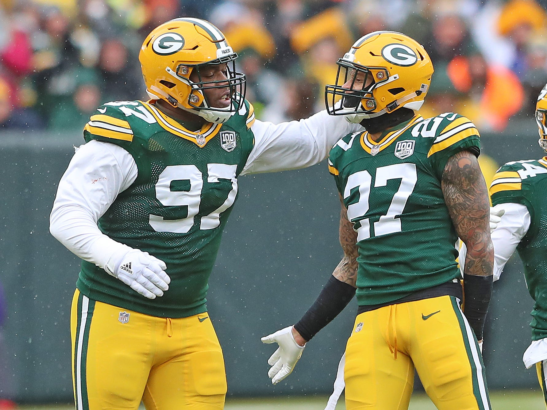 Green Bay Packers defensive back Josh Jones (27) and nose tackle Kenny Clark (97) celebrate a defensive stop against the Arizona Cardinals Sunday, December 2, 2018 at Lambeau Field in Green Bay, Wis. Jim Matthews/USA TODAY NETWORK-Wis