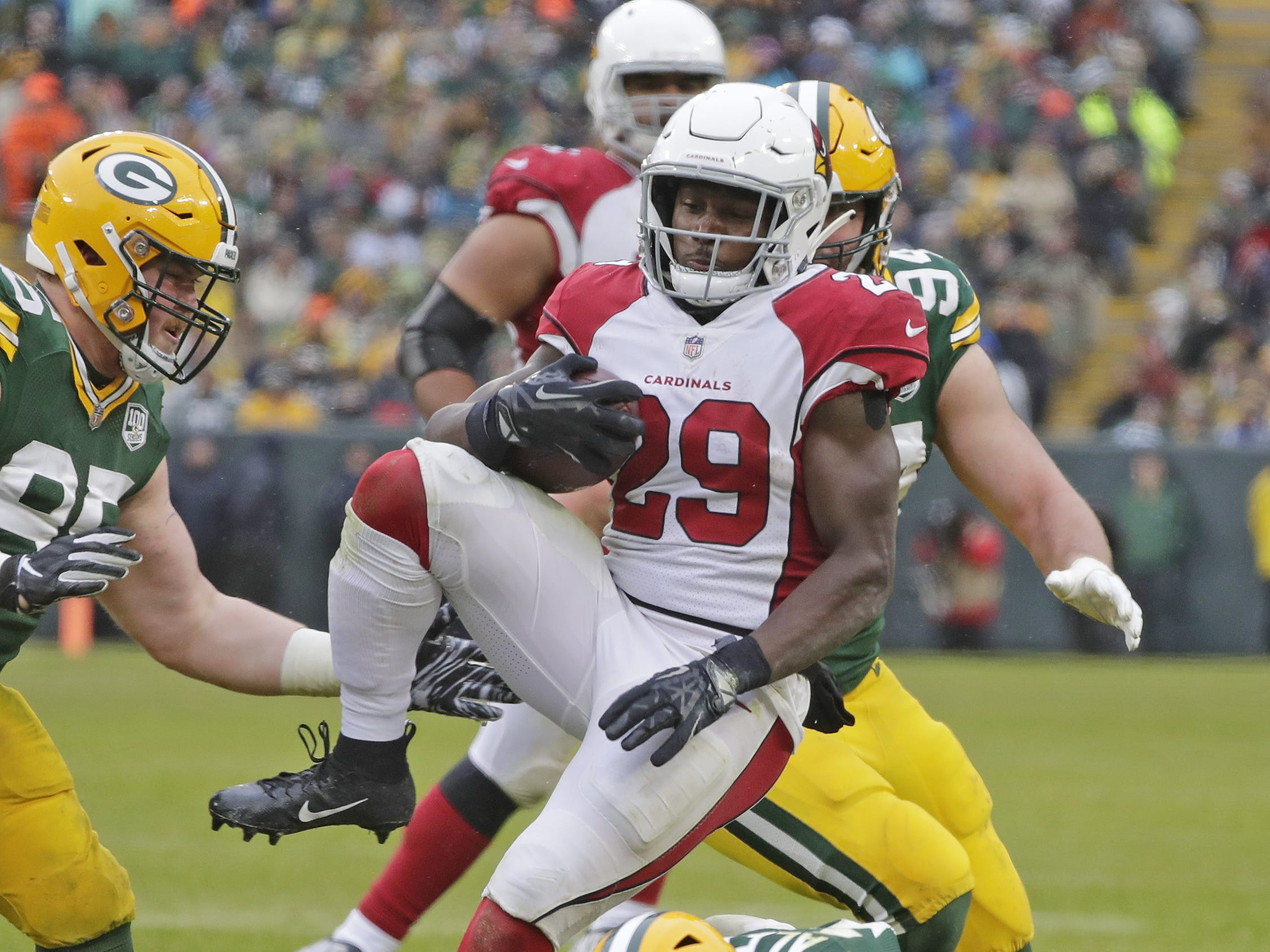 Green Bay Packers cornerback Jaire Alexander (23) tackles Arizona Cardinals running back Chase Edmonds (29) in the fourth quarter at Lambeau Field on Sunday, December 2, 2018 in Green Bay, Wis.