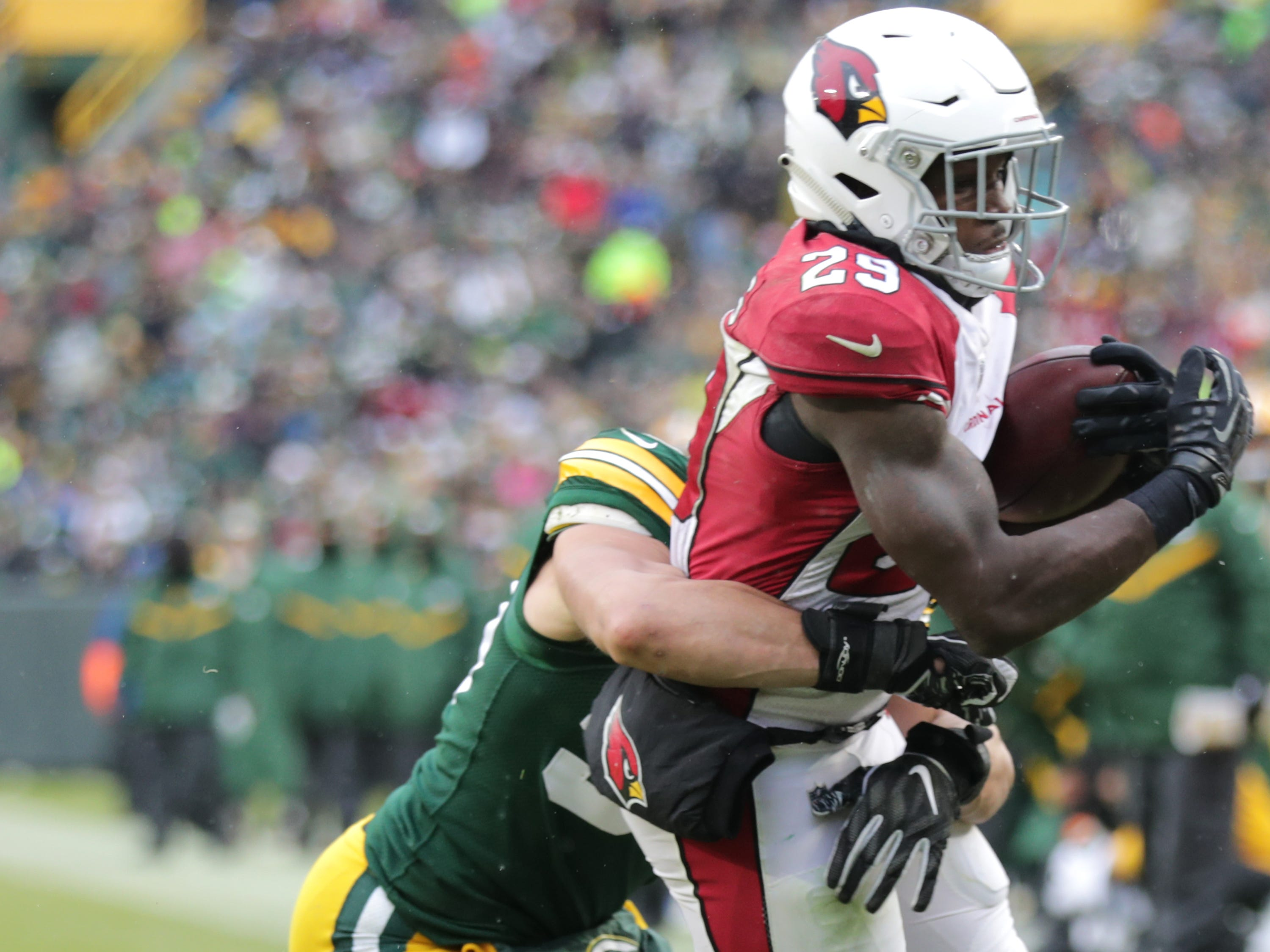 Arizona Cardinals running back Chase Edmonds crosses the goal line in the third quarter against the defense of Green Bay Packers inside linebacker Blake Martinez during their football game on Sunday, December 2, 2018, at Lambeau Field in Green Bay, Wis. Wm. Glasheen/USA TODAY NETWORK-Wisconsin.