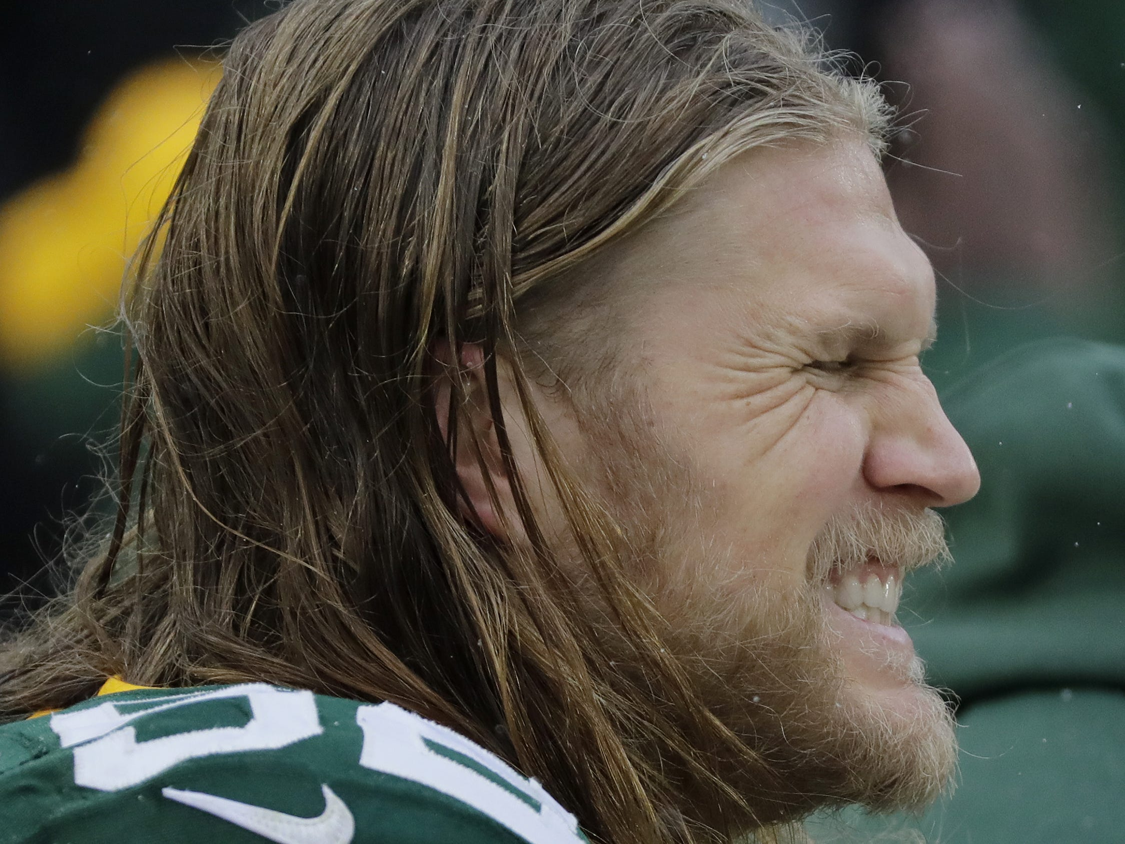 Green Bay Packers outside linebacker Clay Matthews (52) grimaces while his foot is attended to by the medical staff during the second half against the Arizona Cardinals at Lambeau Field on Sunday, December 2, 2018 in Green Bay, Wis.