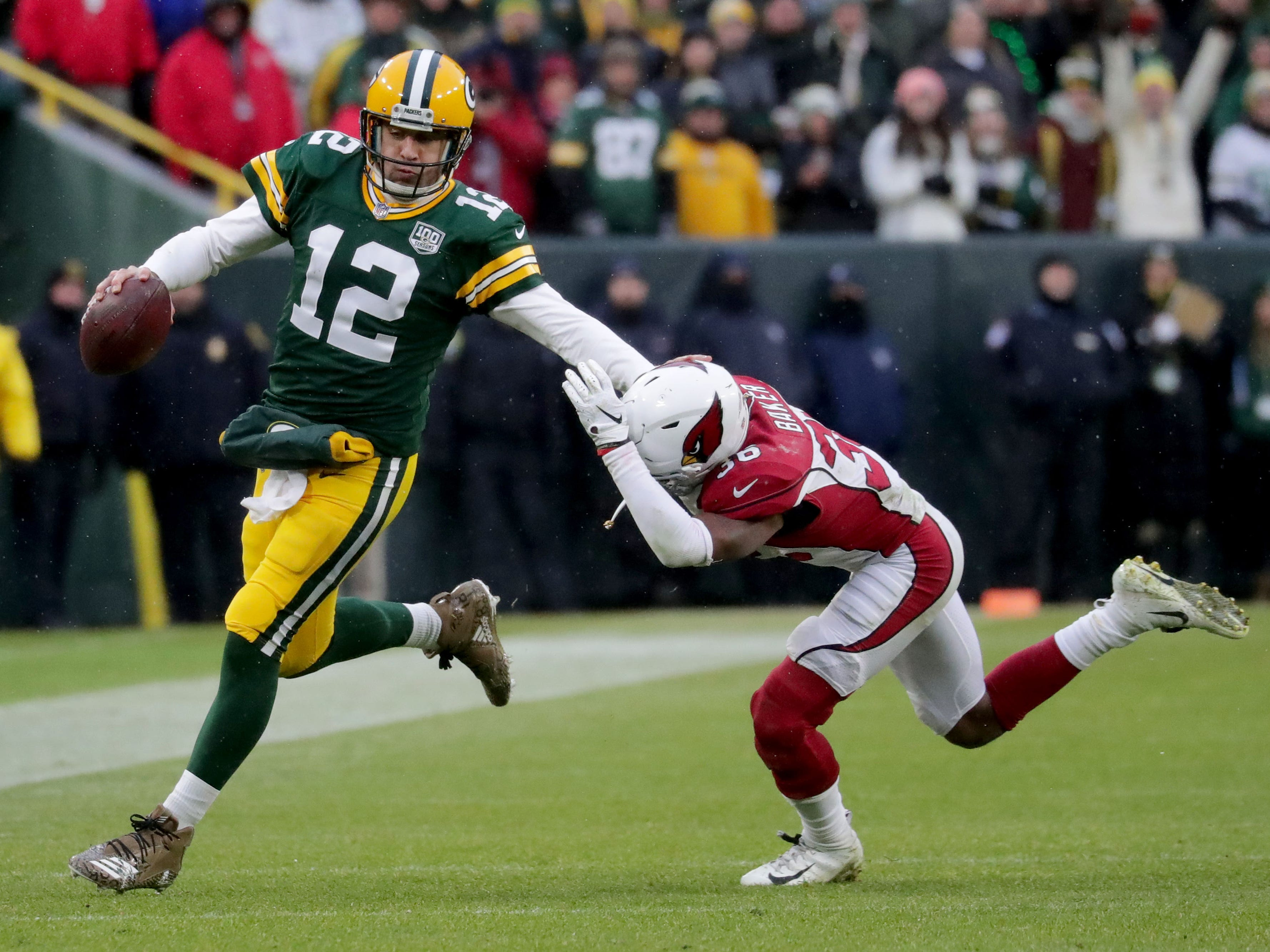 Green Bay Packers quarterback Aaron Rodgers (12) stiff arms Arizona Cardinals strong safety Budda Baker (36) during the 4th quarter of Green Bay Packers game 20-17 loss against the Arizona Cardinals on Sunday, December 2, 2018 at Lambeau Field in Green Bay, Wis. Mike De Sisti / USA TODAY NETWORK-Wis