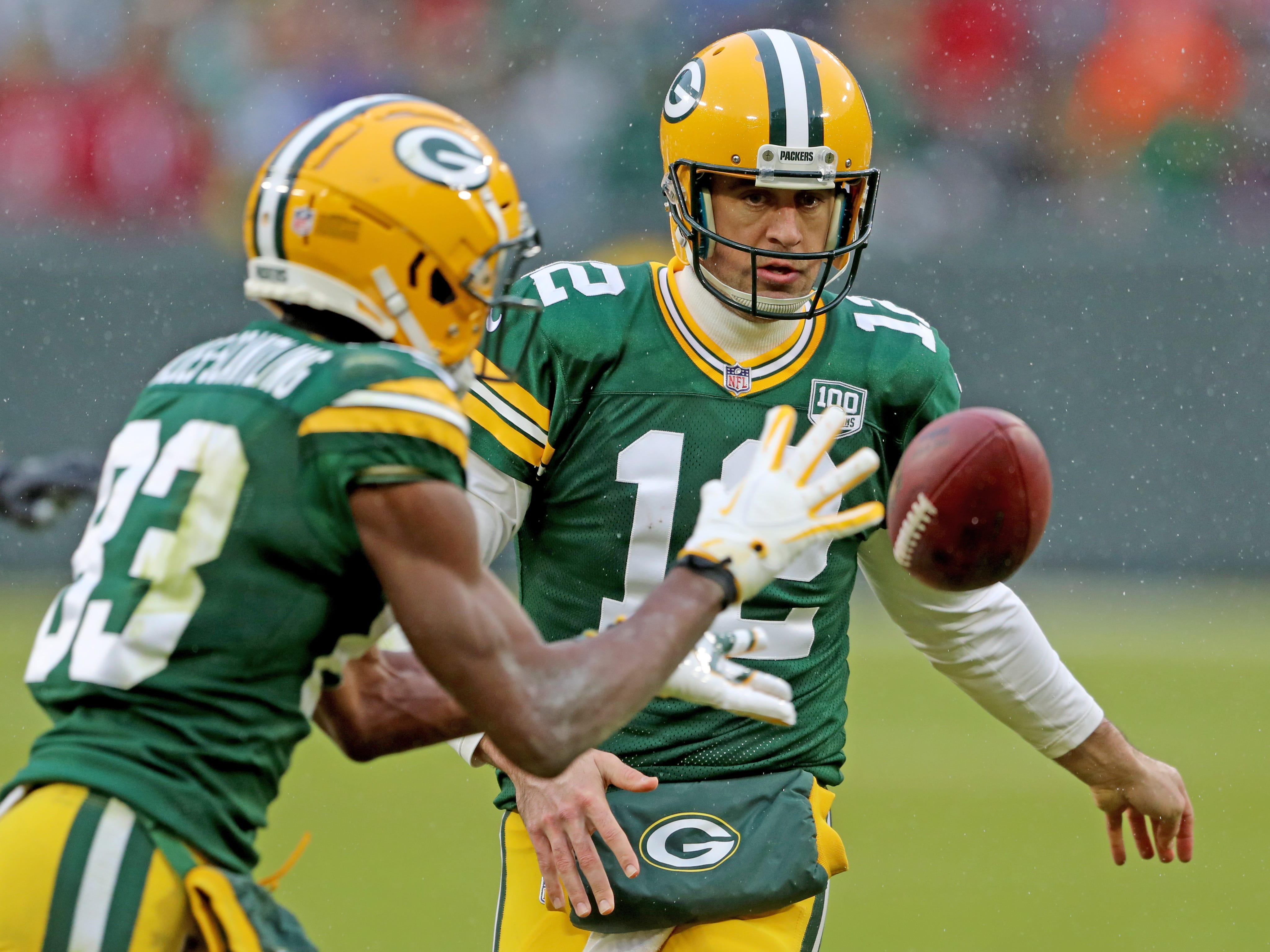 Green Bay Packers wide receiver Marquez Valdes-Scantling (83) takes the pitch from quarterback Aaron Rodgers (12) on a reverse against the Arizona Cardinals Sunday, December 2, 2018 at Lambeau Field in Green Bay, Wis. Jim Matthews/USA TODAY NETWORK-Wis