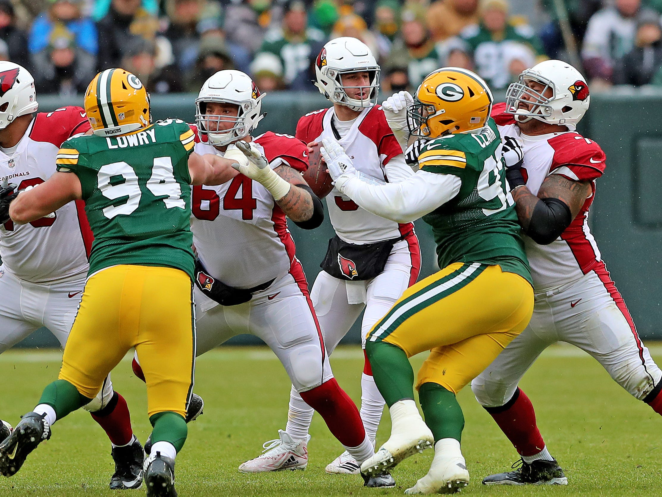Green Bay Packers defensive end Dean Lowry (94) and nose tackle Kenny Clark (97) rush quarterback Josh Rosen (3) against the Arizona Cardinals Sunday, December 2, 2018 at Lambeau Field in Green Bay, Wis. Jim Matthews/USA TODAY NETWORK-Wis