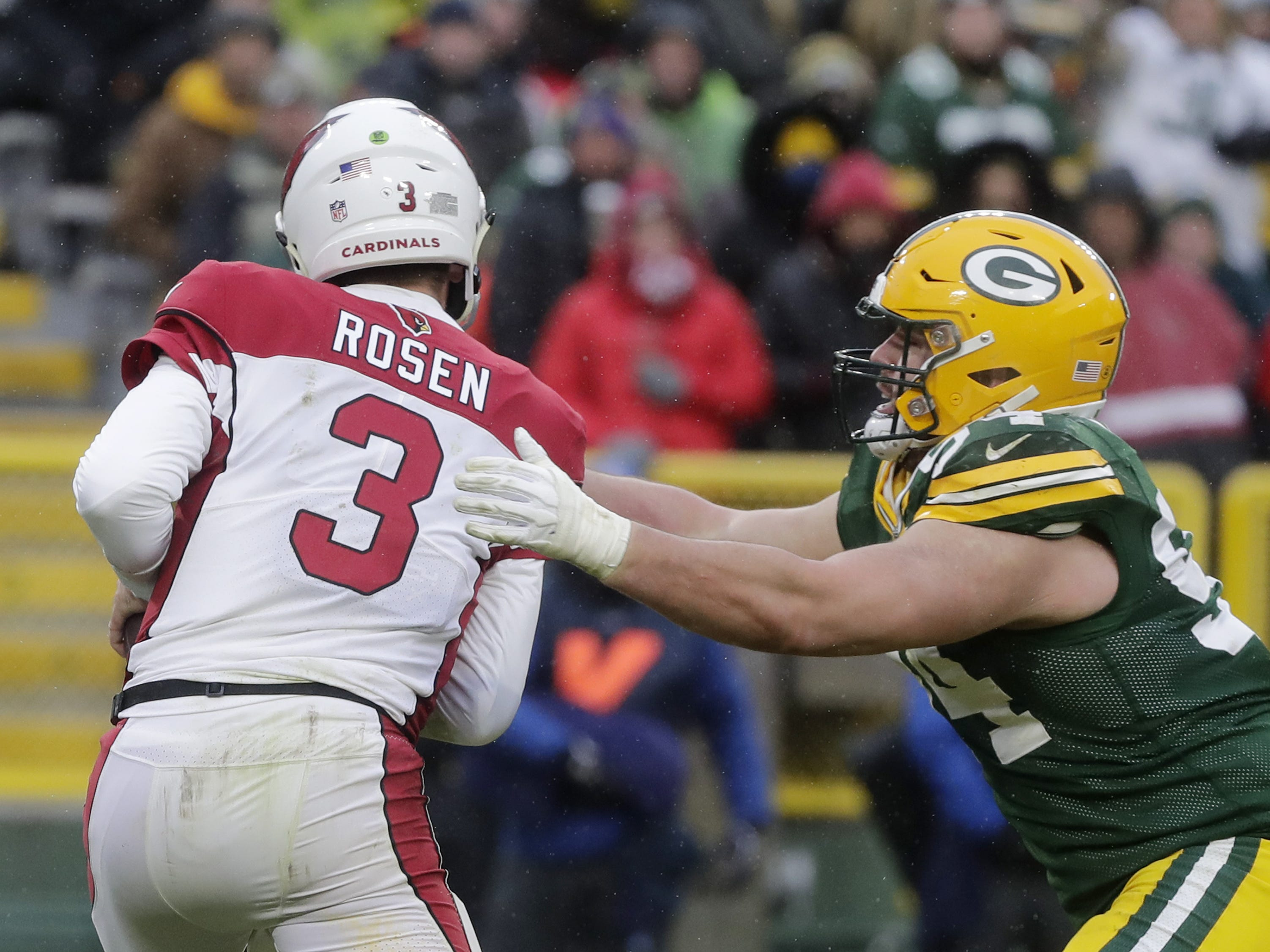 Green Bay Packers defensive end Dean Lowry (94) sacks Arizona Cardinals quarterback Josh Rosen (3) in the fourth quarter at Lambeau Field on Sunday, December 2, 2018 in Green Bay, Wis.