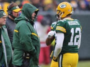 Green Bay Packers quarterback Aaron Rodgers (12) talks with Green Bay Packers' Mike McCarthy against the Arizona Cardinals Sunday, December 2, 2018 at Lambeau Field in Green Bay, Wis. Jim Matthews/USA TODAY NETWORK-Wis