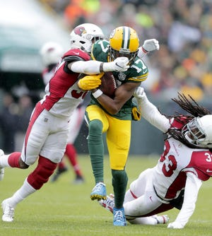 Green Bay Packers wide receiver Davante Adams is tackled by Arizona Cardinals strong safety Budda Baker during  the second quarter of their football game on Sunday, December 2, 2018, at Lambeau Field in Green Bay, Wis. Wm. Glasheen/USA TODAY NETWORK-Wisconsin.