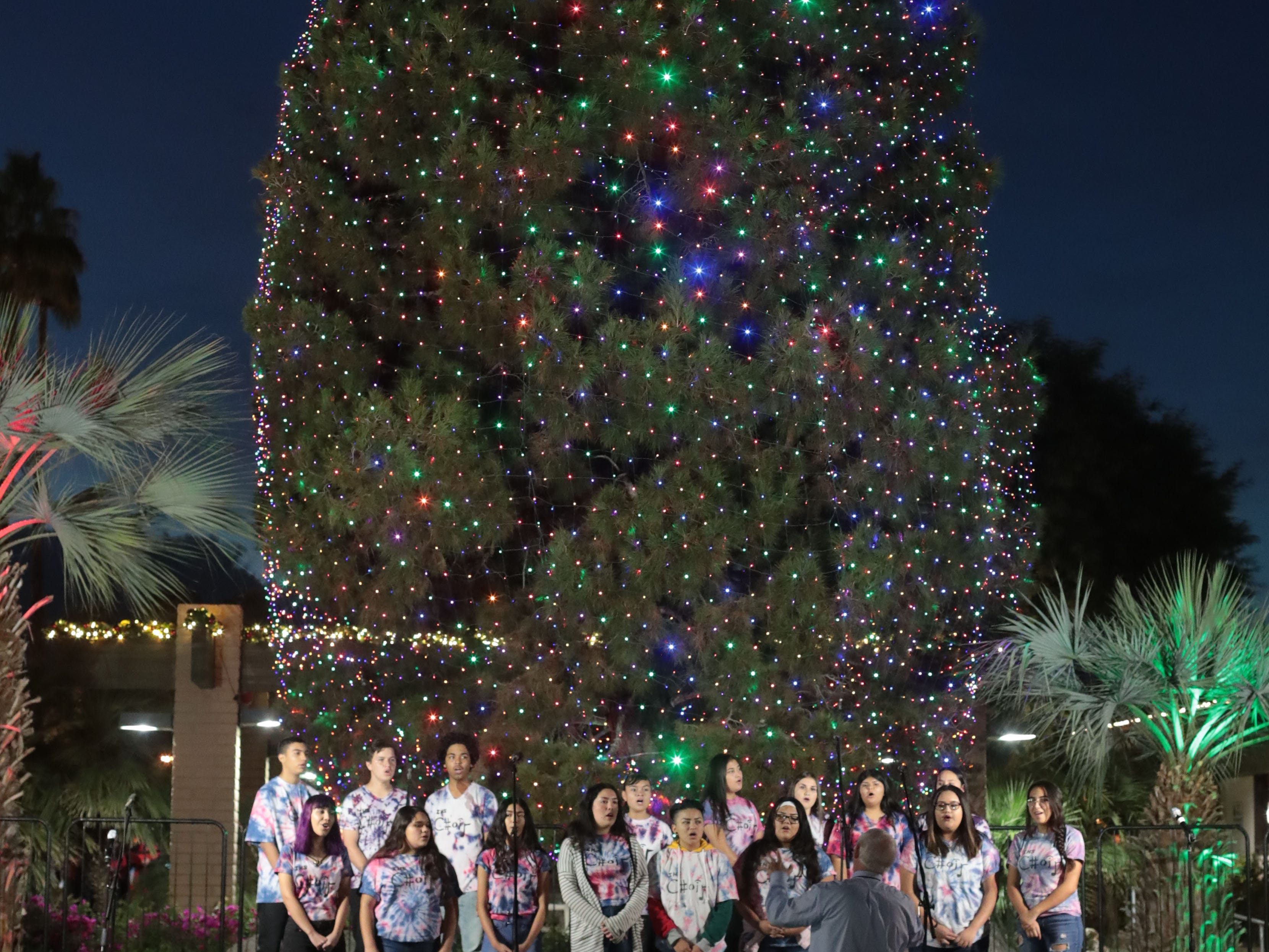 The Indio High School Mixed Chorus sing at the City of Indio's Christmas tree lighting on Saturday, December 1, 2018 in Indio.
