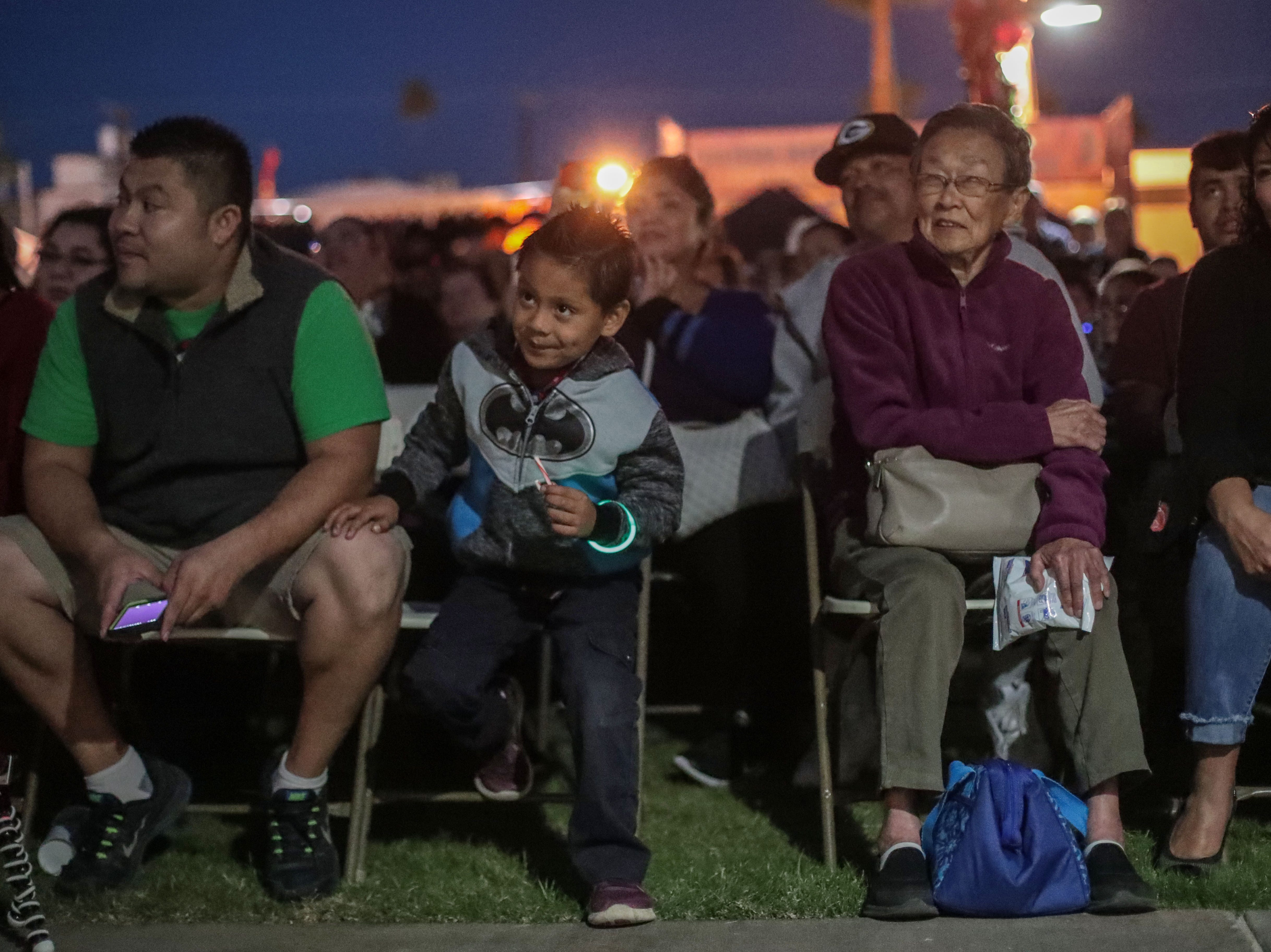 Families anticipate the lighting of City of Indio's Christmas tree on Saturday, December 1, 2018 in Indio.