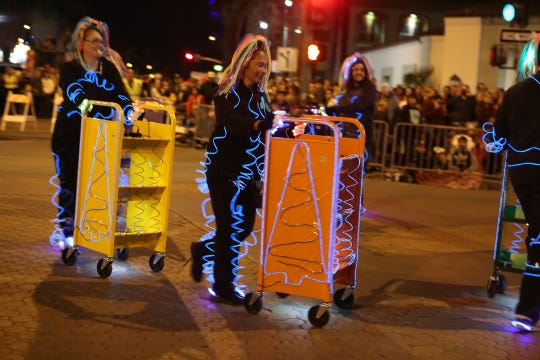 Staff of the Palm Springs Library participate in the 26th annual Palm Springs Festival of Lights parade in downtown Palm Springs on December 1, 2018.