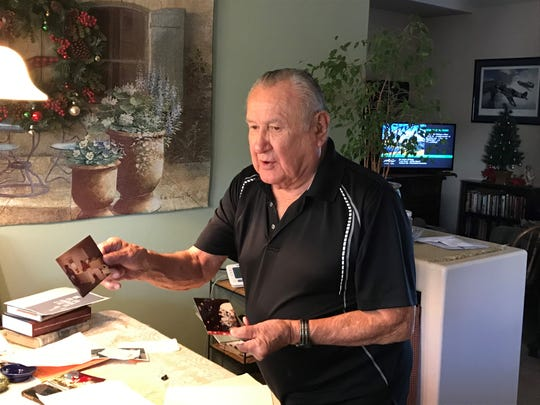 Former Palm Springs High School teacher Bob Andrade shows off photos of himself and students who shuttled former President George H.W. Bush's Cabinet to a Rancho Mirage summit in 1990.