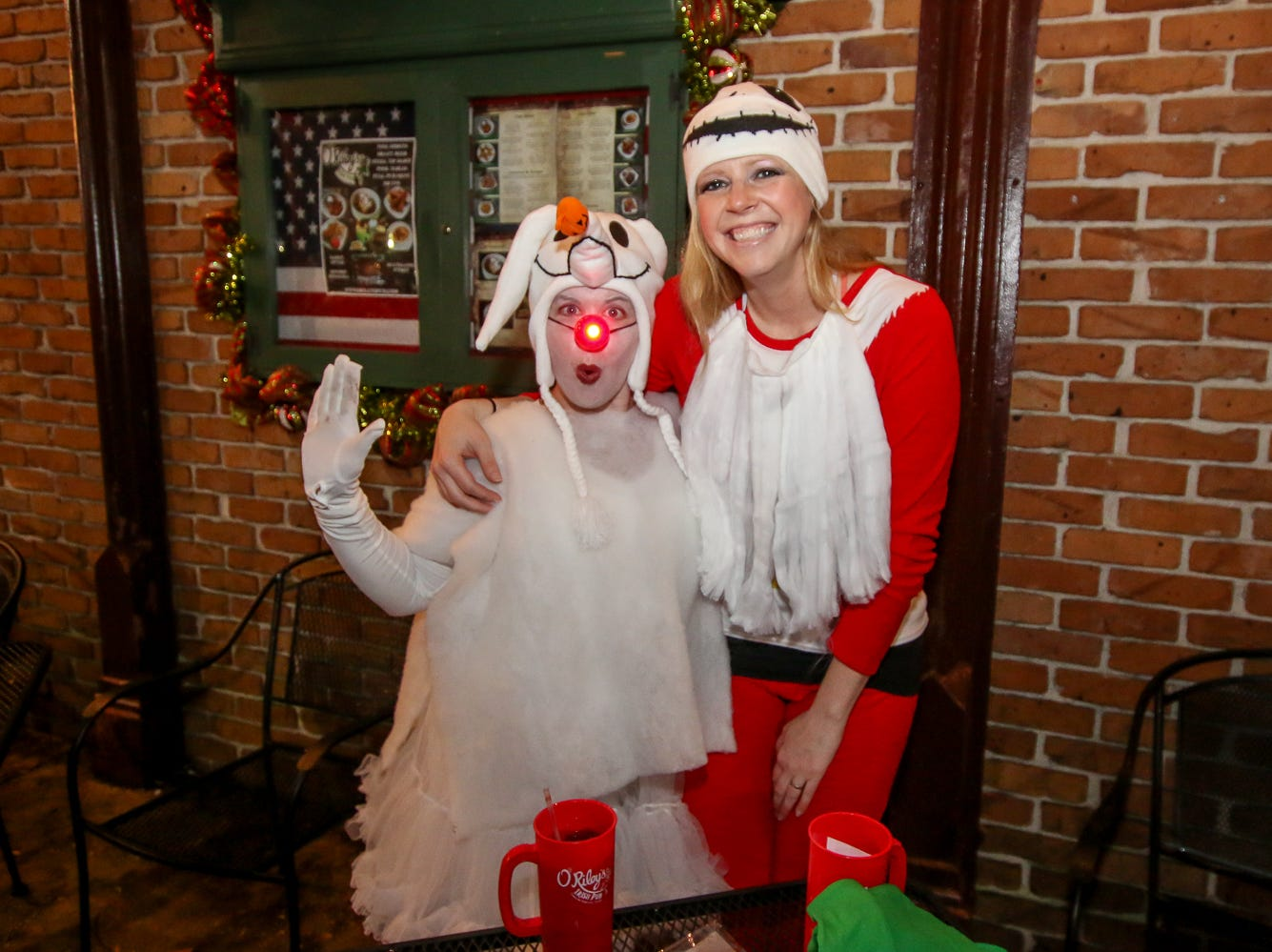 Heavy rain throughout the day didn't stop hundreds of people from joining in on O'Riley's Irish Pub's 6th annual Santa Pub Crawl through downtown Pensacola on Saturday, December 1, 2018. The event raises cash donations and toys for local charities.
