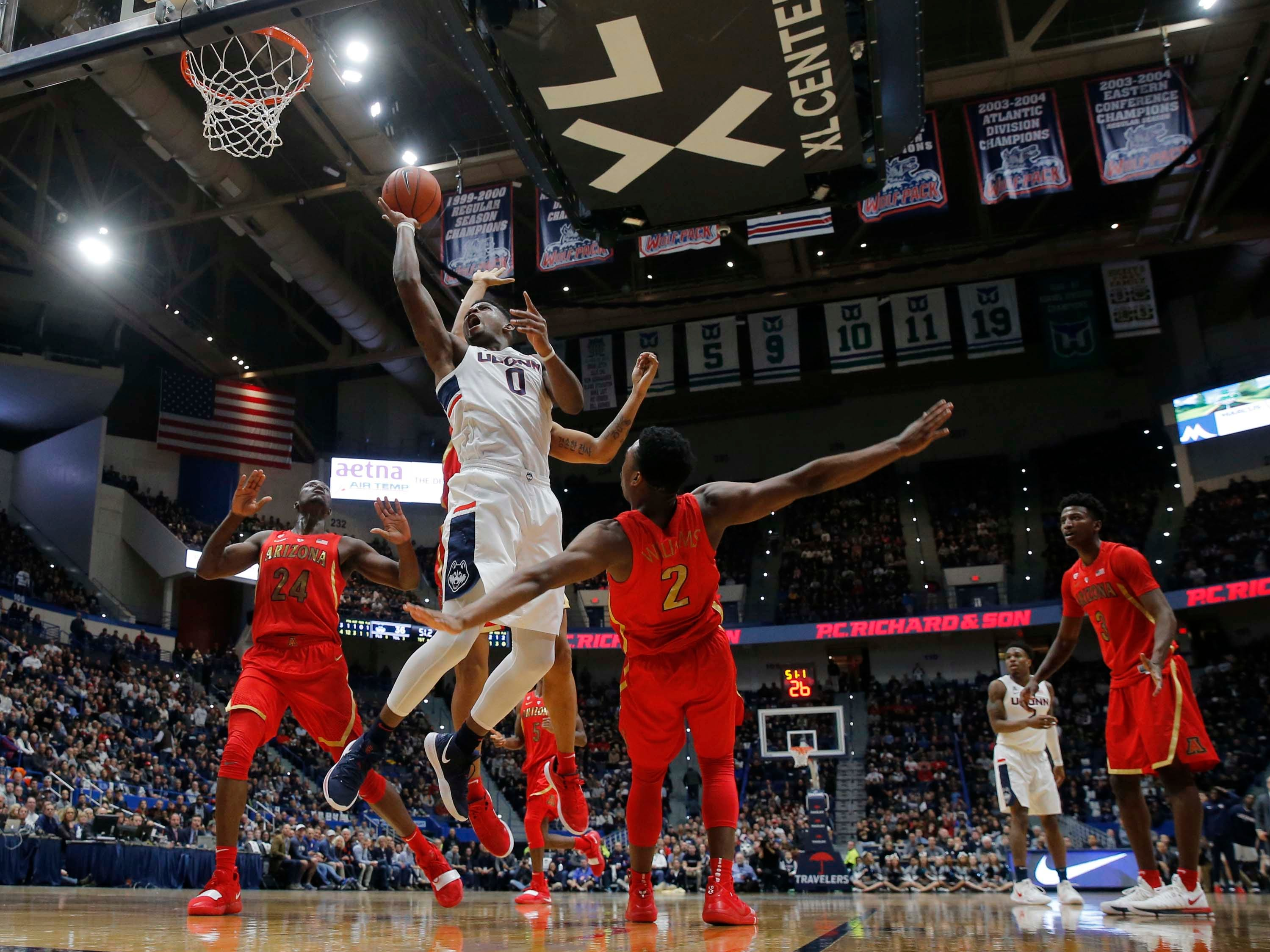 Dec 2, 2018; Storrs, CT, USA; Connecticut Huskies forward Eric Cobb (0) shoots against the Arizona Wildcats in the first half at XL Center. Mandatory Credit: David Butler II-USA TODAY Sports