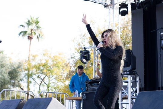 Miss Chola AzStar performs on stage lip syncing to various songs at the Latino Pride Festival at Corona Ranch in Phoenix on Dec. 1