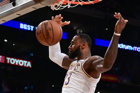 Dec 2, 2018; Los Angeles, CA, USA; Los Angeles Lakers forward LeBron James (23) throws down a slam dunk during the third quarter against the Phoenix Suns at Staples Center. Mandatory Credit: Robert Hanashiro-USA TODAY Sports