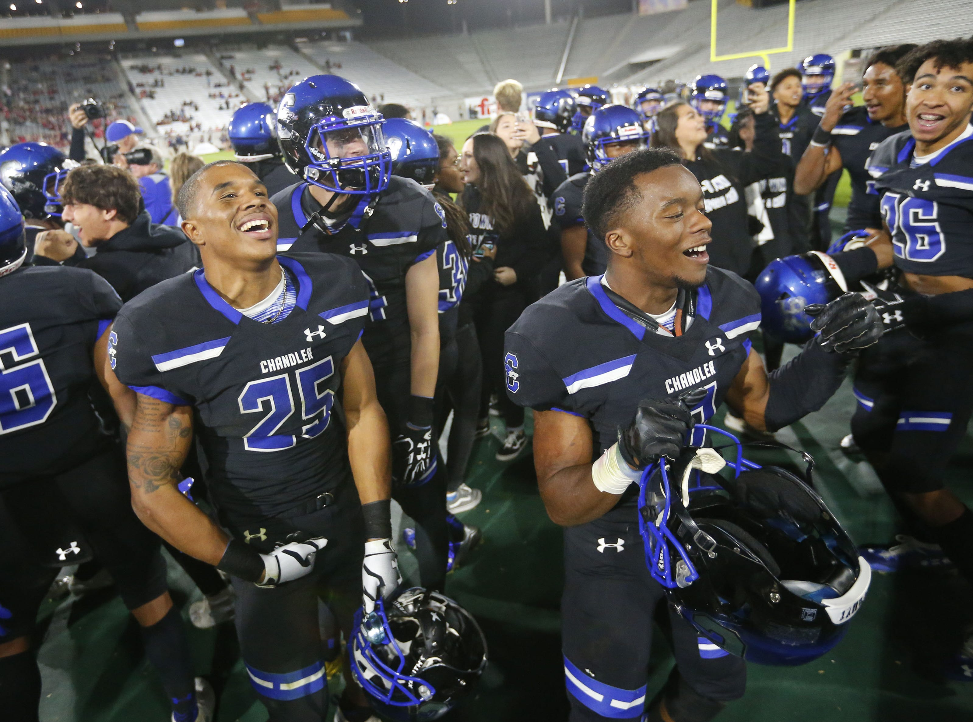 Chandler running back Decarlos Brooks (25) and his teammates celebrate their 65-28 win against Perry in the 6A state football championship game at Sun Devil Stadium December 1, 2018. #azhsfb