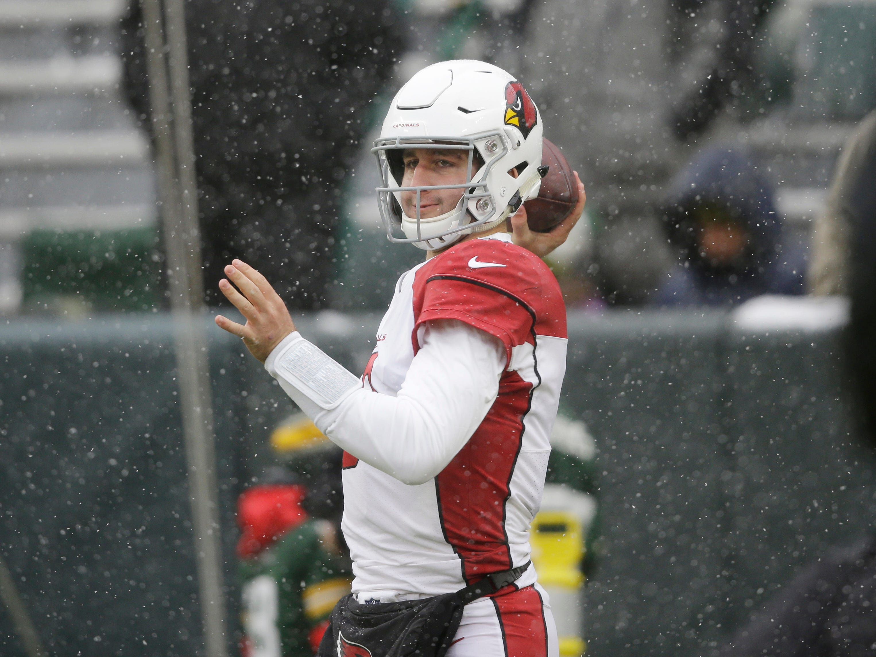 Arizona Cardinals quarterback Josh Rosen warms up before an NFL football game between the Green Bay Packers and the Arizona Cardinals Sunday, Dec. 2, 2018, in Green Bay, Wis. (AP Photo/Jeffrey Phelps)