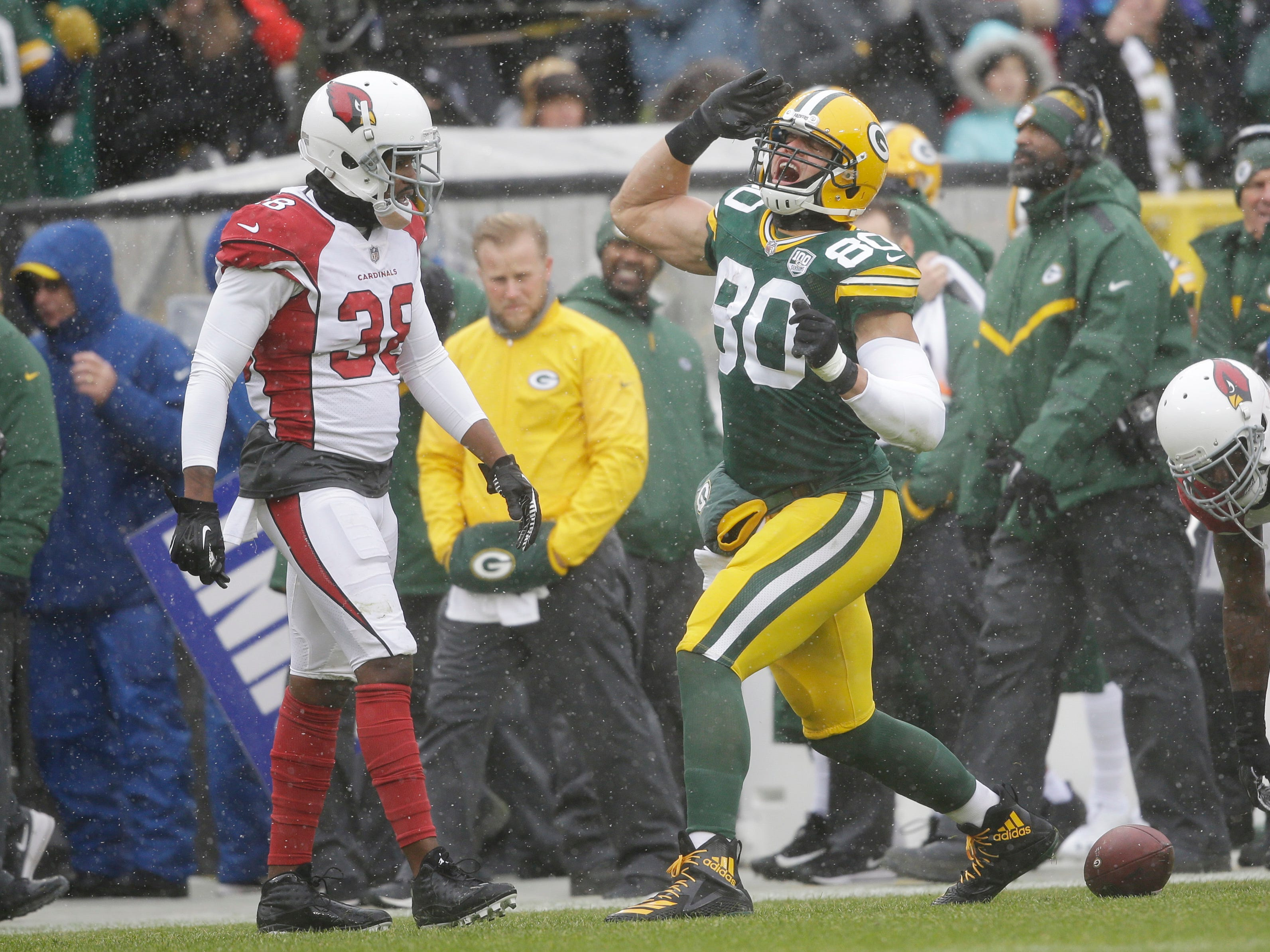 Green Bay Packers tight end Jimmy Graham signals first down during the first half of an NFL football game against the Arizona Cardinals Sunday, Dec. 2, 2018, in Green Bay, Wis. (AP Photo/Jeffrey Phelps)
