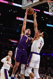 Dec 2, 2018; Los Angeles, CA, USA; Phoenix Suns guard Devin Booker (1) shoots over Los Angeles Lakers guard Josh Hart (3) during the second quarter at Staples Center. Mandatory Credit: Robert Hanashiro-USA TODAY Sports